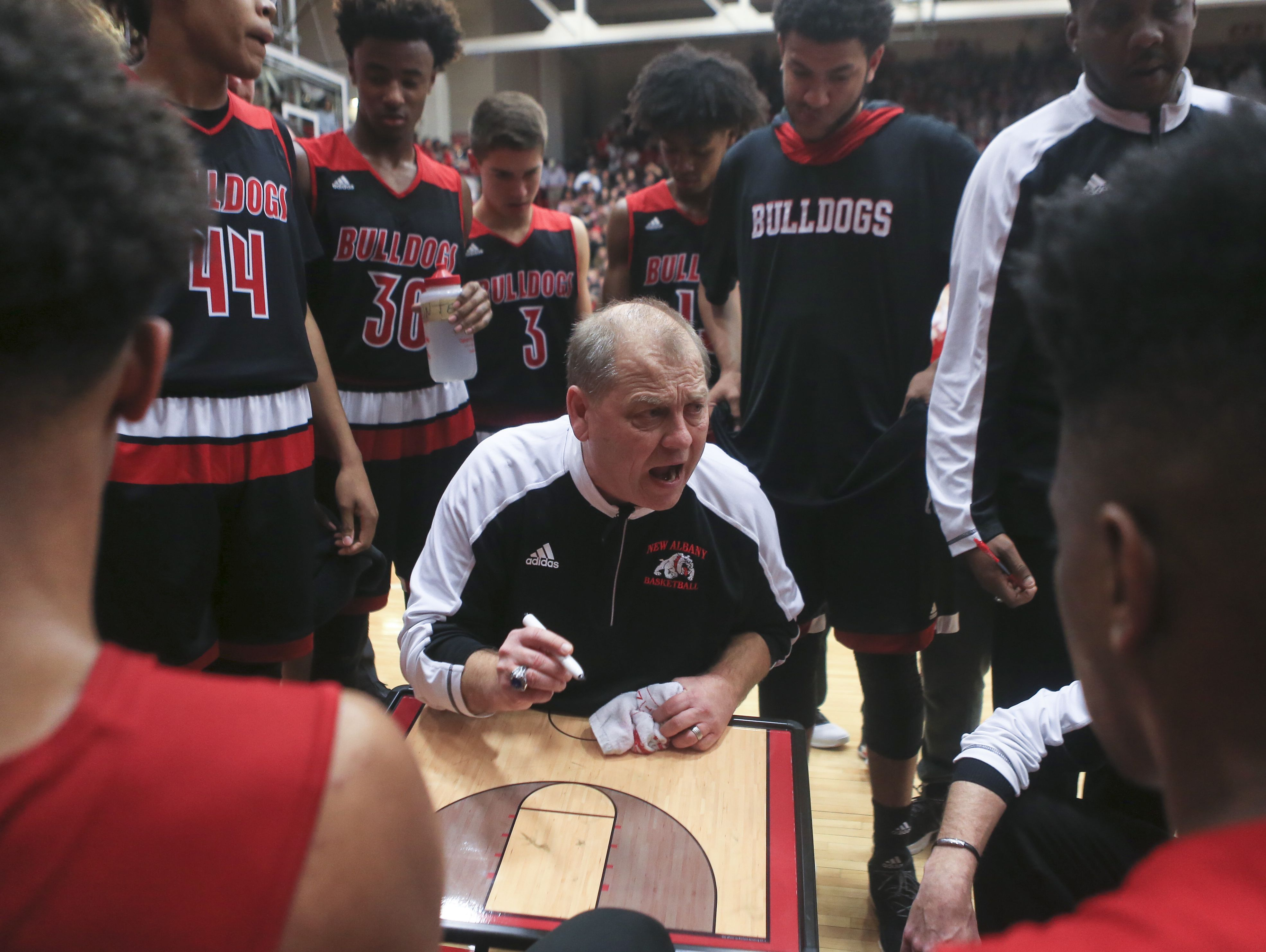 New Albany boys coach Jim Shannon motivates his team during a timeout in the game against Jeff Jan. 6, 2017.