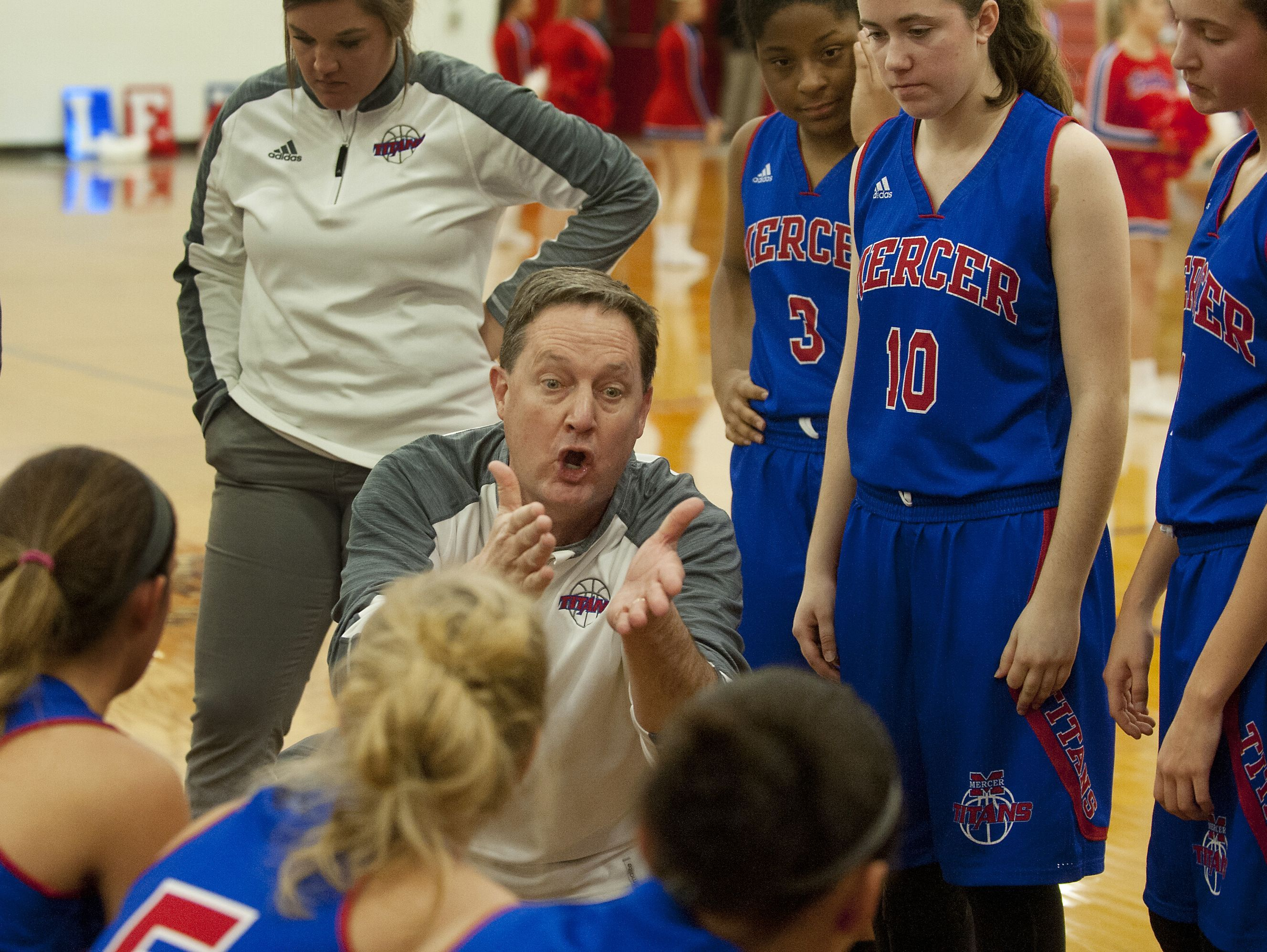 Mercer County head basketball coach Chris G. Souder makes a strong point to his players during a time-out. 07 January 2017