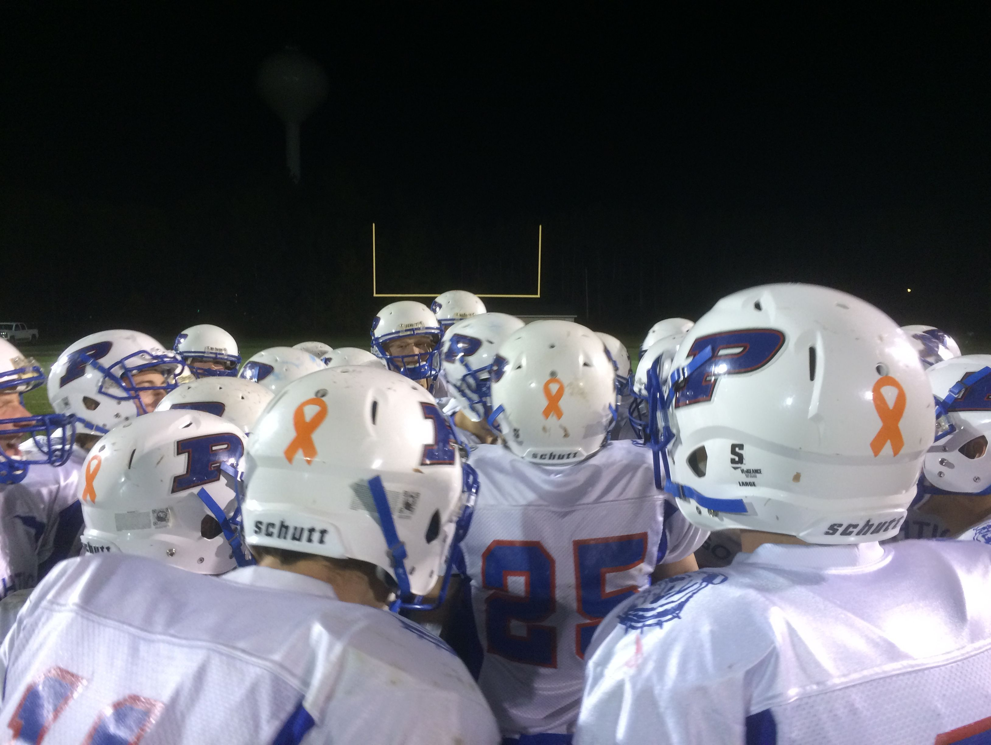 The Peshtigo football team placed orange decals on the back of their helmets to show support for Meghan Harper, an eighth-grader in the school district, who was diagnosed with leukemia.