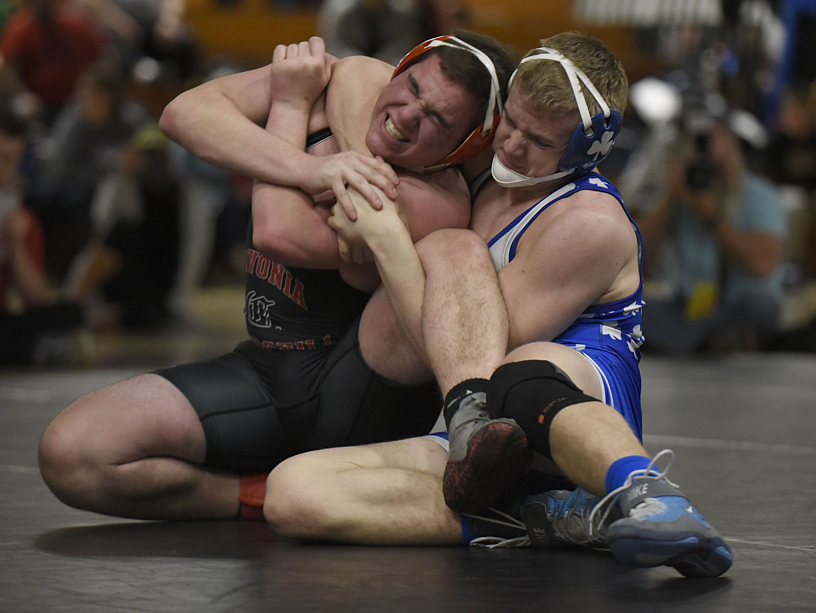 Catholic Central's Dane Flynn (right) grapples Churchill's Nick Dlugos in the 189 final.
