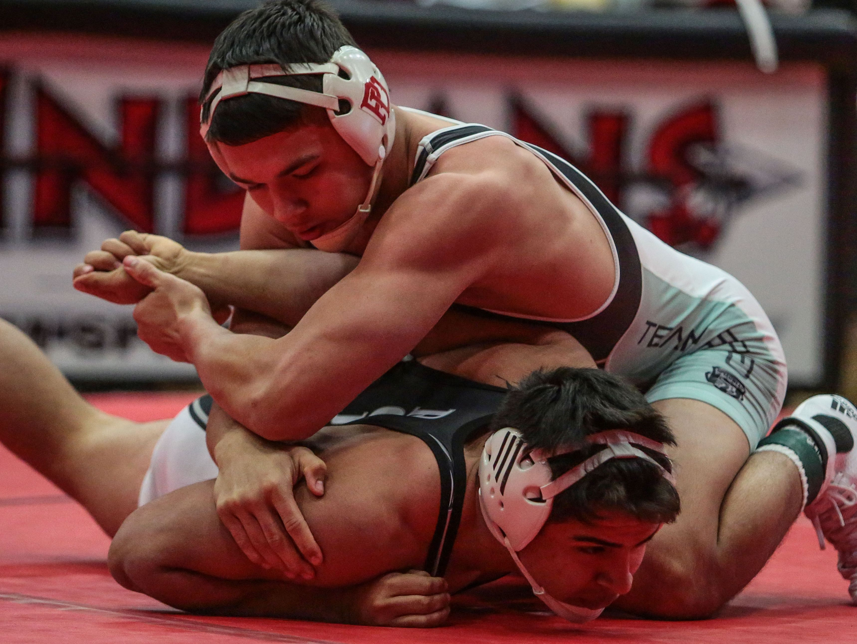 Palm Desert's Anthony Mantanona, left, wrestles Shadow Hills' Tommy Rojas in the 170 lbs. DVL individual wresting final Saturday, January 28, 2017 at Palm Springs High. Mantanona won the title.