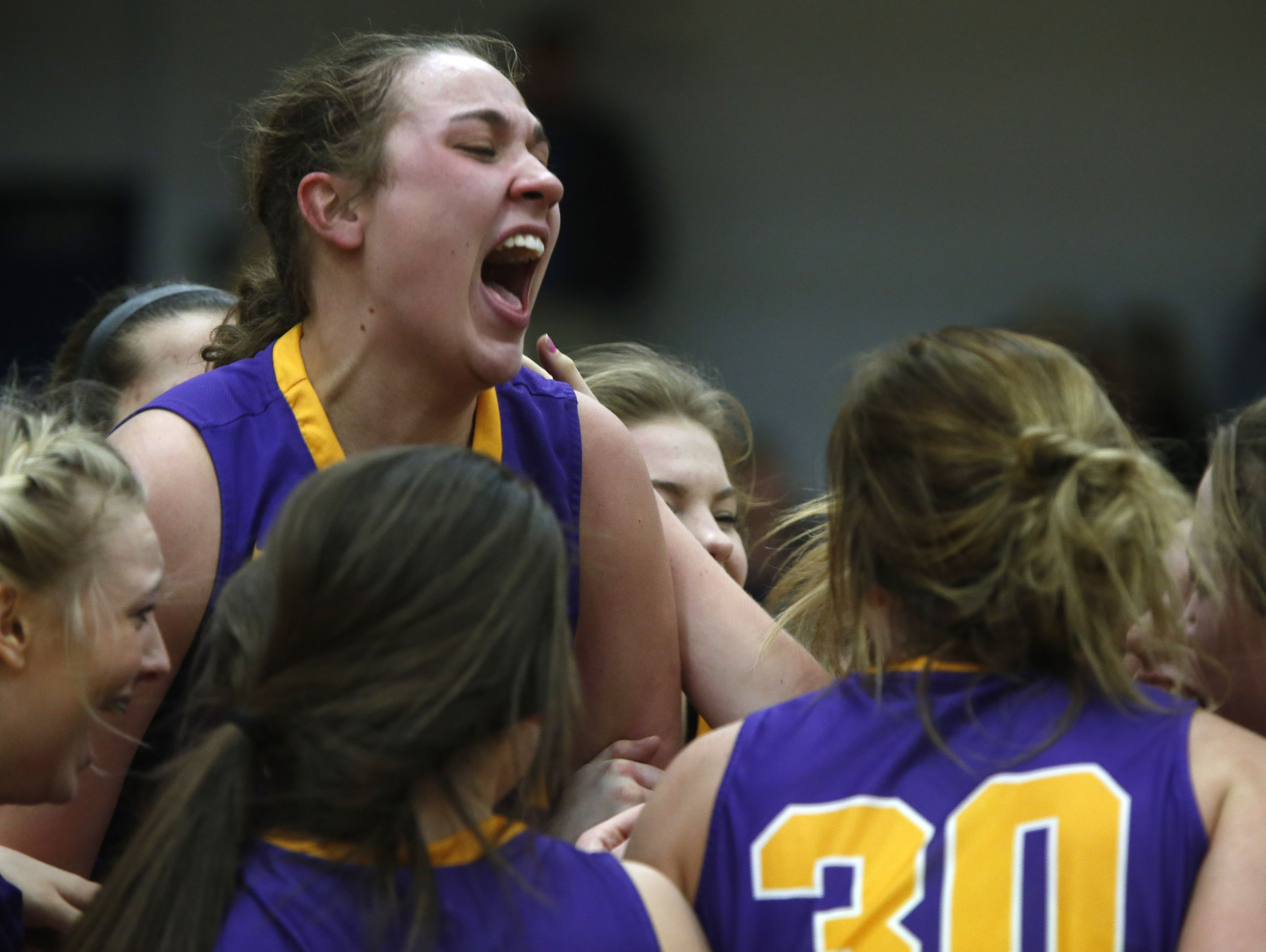 Eastern Pekin's Taylor Drury celebrates with teammates after their victory over Providence in the Indiana girls sectional final. Jan. 4, 2017.