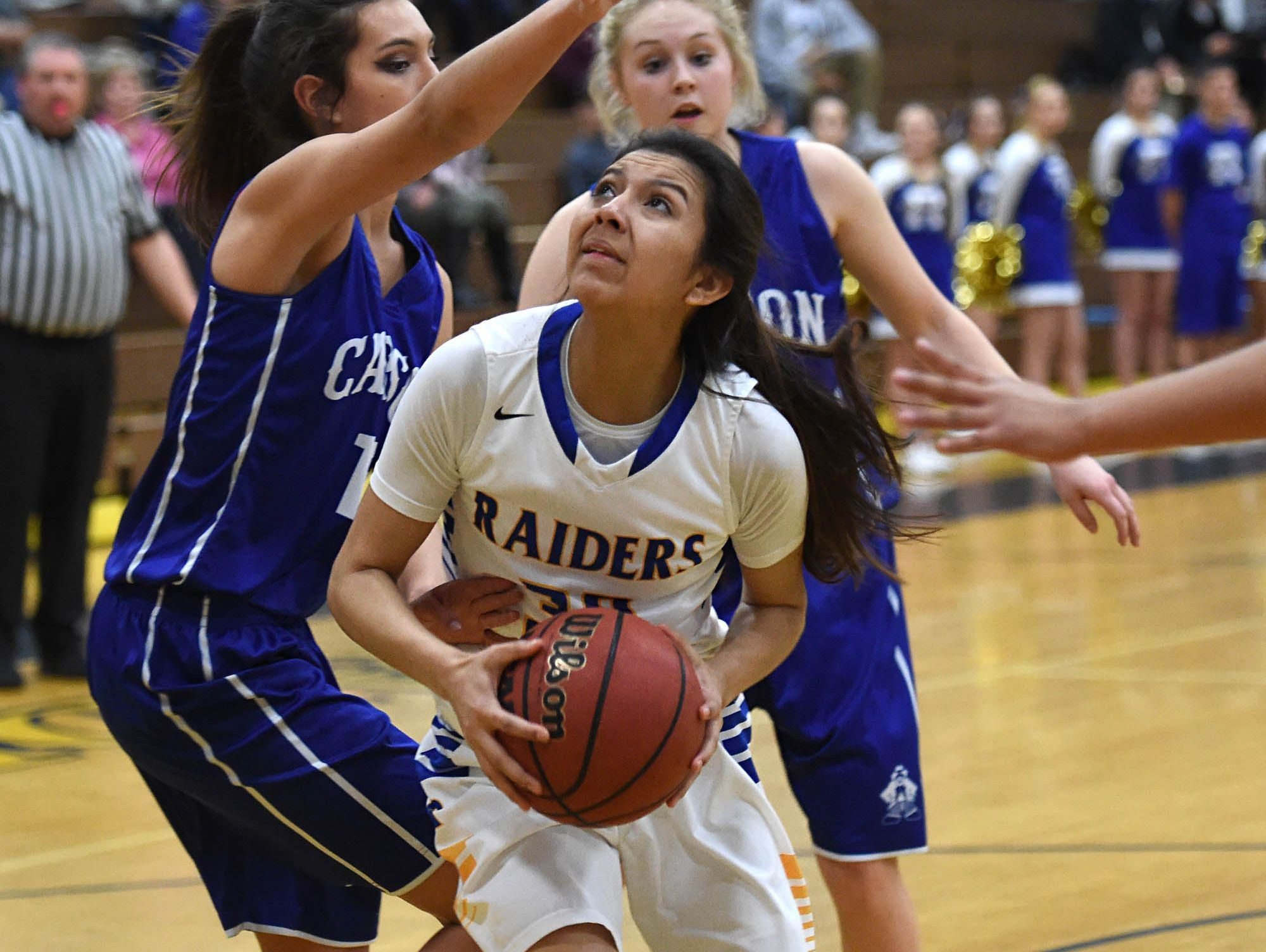 Reed's Larsa Guzman looks to shoot with Carson's Dajarrah Navarro covering her in the first half of Wednesday's playoff game at Reed.