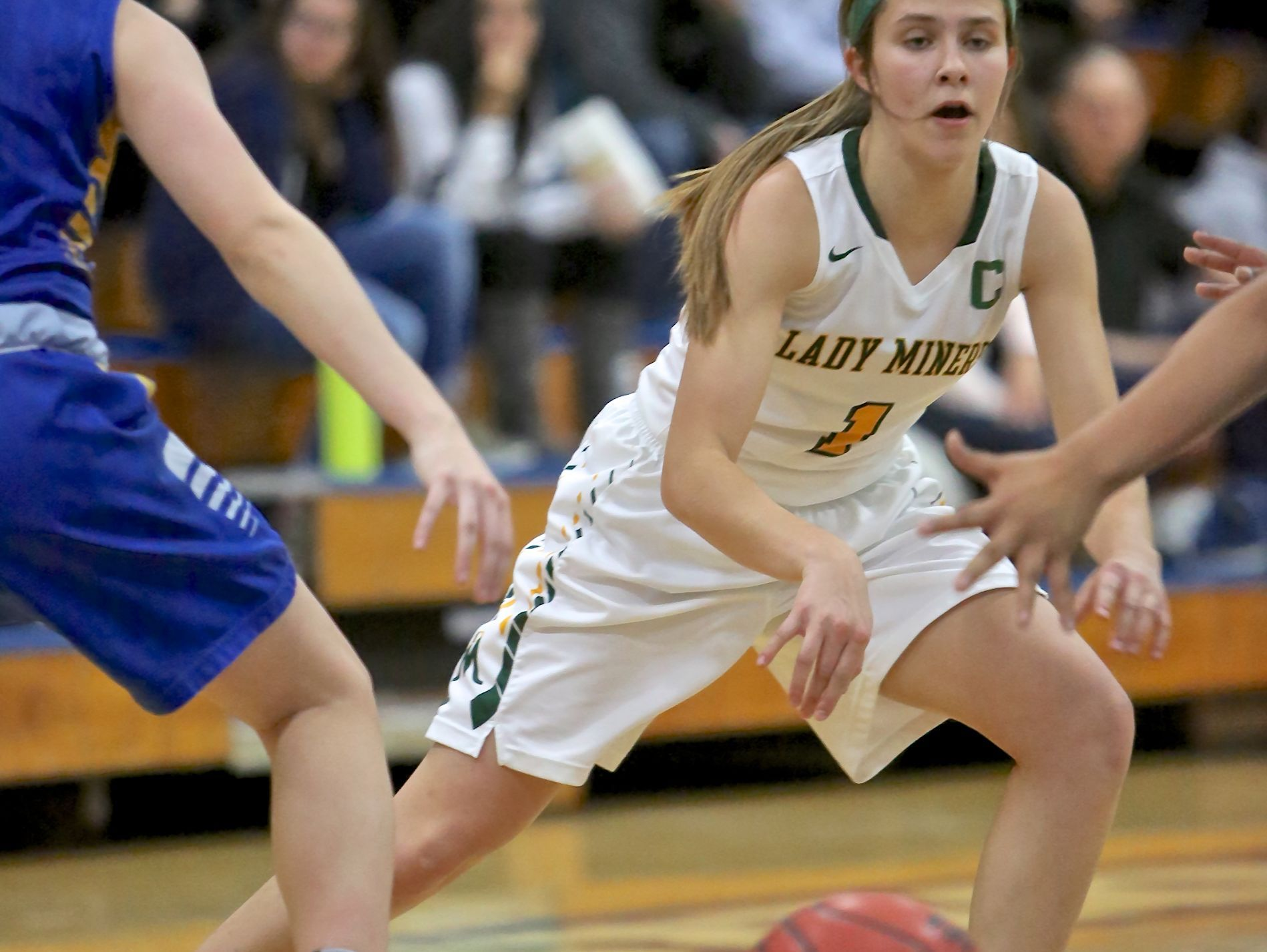 Bishop Manogue's Katie Turner looks for an opening Friday against Reed. The Miners won, 62-45.