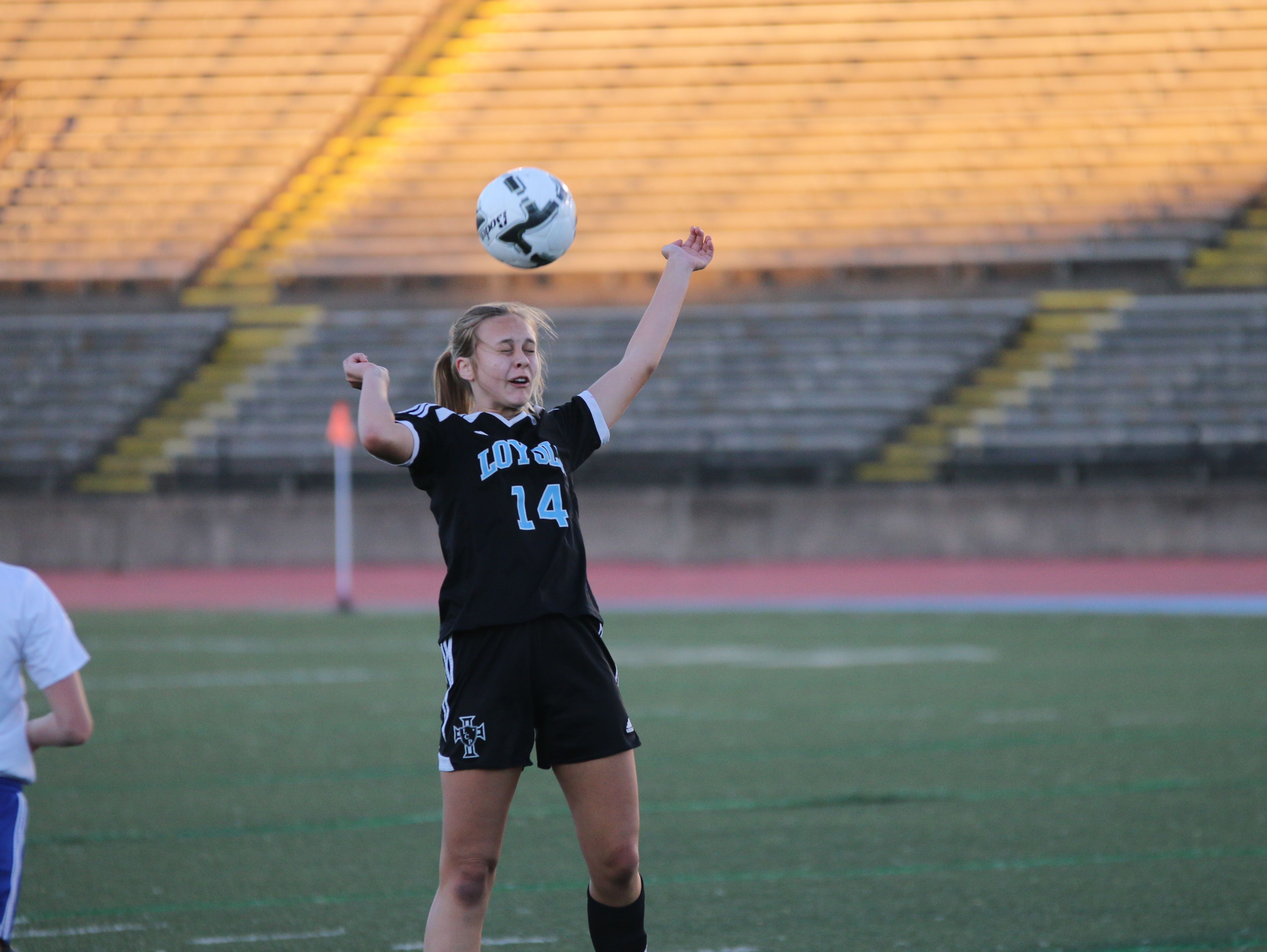 Loyola's Gracie Payne heads a ball in Wednesday's Division III state championship girls soccer game vs. Vandebilt Catholic at Tad Gormley Stadium in New Orleans.