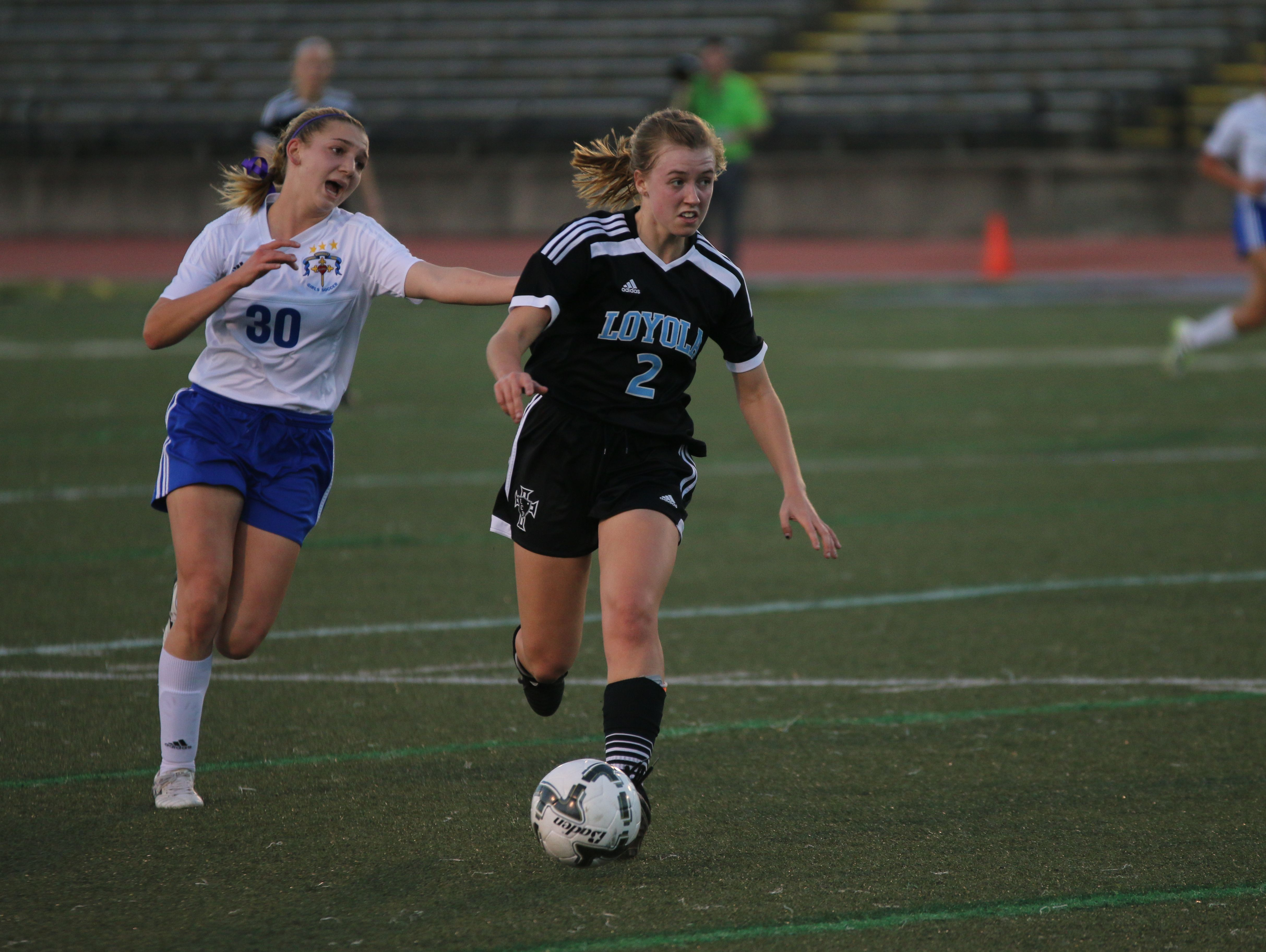Loyola's Elizabeth Bryan attempts to outrun a defender in Wednesday's Division III state championship girls soccer game vs. Vandebilt Catholic at Tad Gormley Stadium in New Orleans.