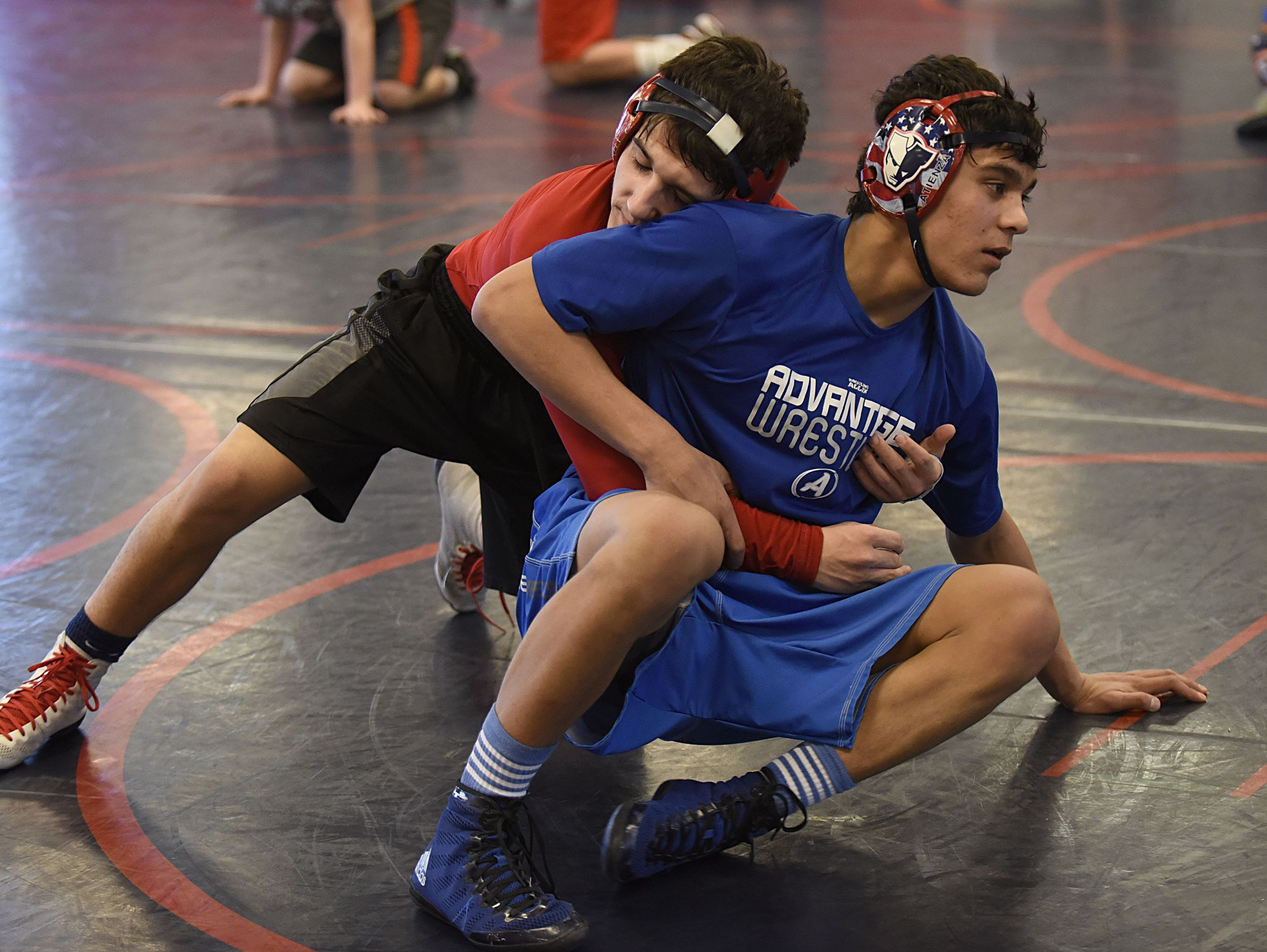 Practices give wrestlers such as Livonia Franklin's Nathan Atienza (right) and Marino DiPonio the chance to push each other beyond their physical limits.