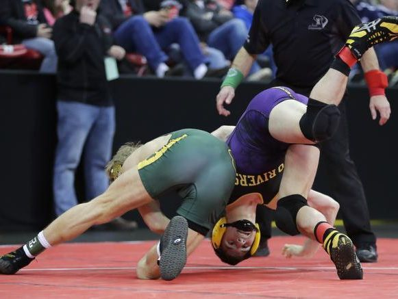 Freedom High SchoolÕs Evan Vosters tries to take down Two Rivers High SchoolÕs Laken Duerschmidt during their 145-pound WIAA Division 2 semifinal match at the 2017 Individual Wrestling State Tournament Friday, Feb. 24, 2017, at the Kohl Center in Madison, Wis. Danny Damiani/USA TODAY NETWORK-Wisconsin