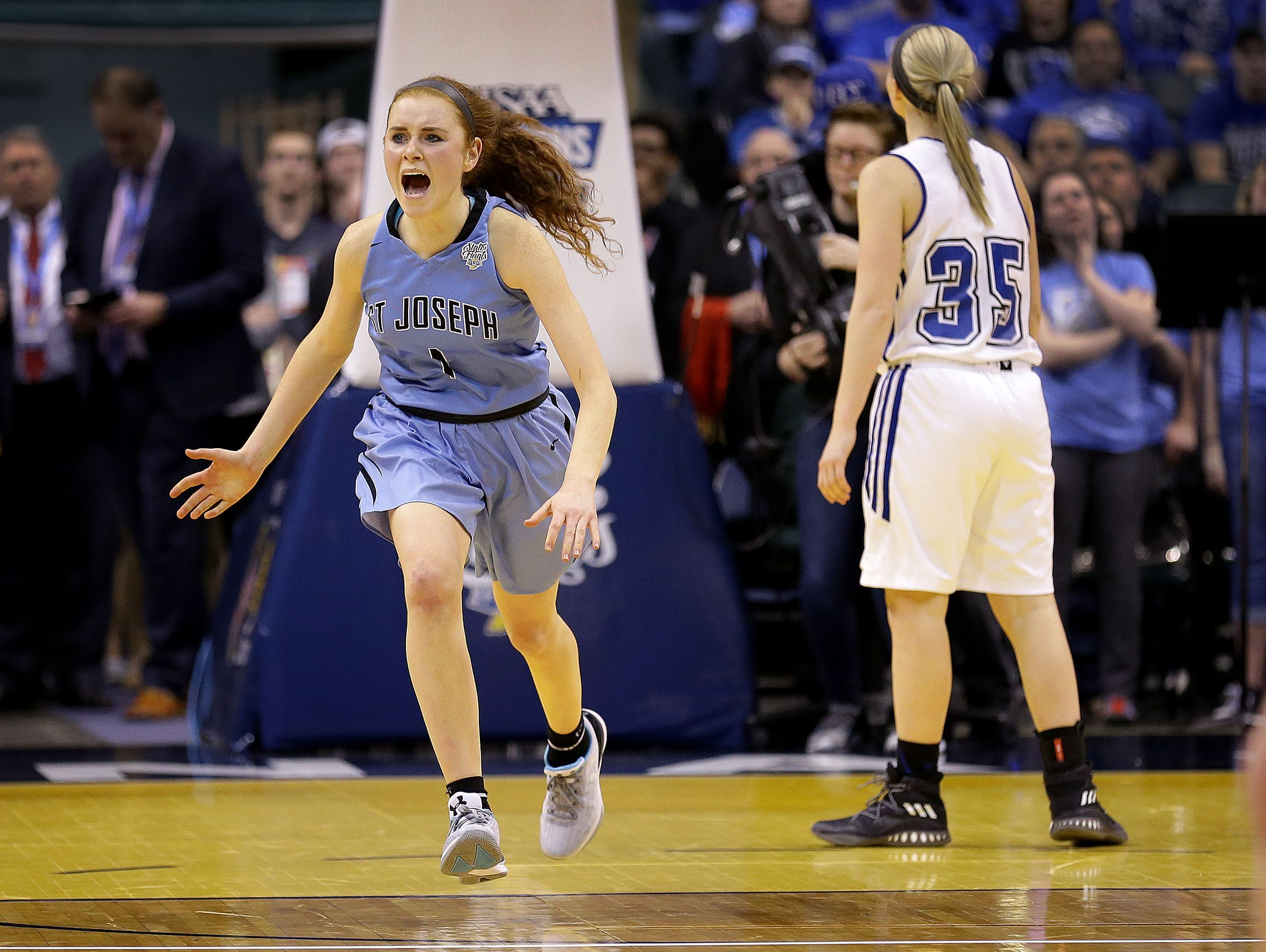 St. Joseph Indians Daly Sullivan (1) celebrates their win in the IHSAA 3A Girls Basketball State Finals game Saturday, February 25, 2017, evening at Bankers Life Fieldhouse. The St. Joseph Indians defeated the North Harrison Lady Cats 57-49.