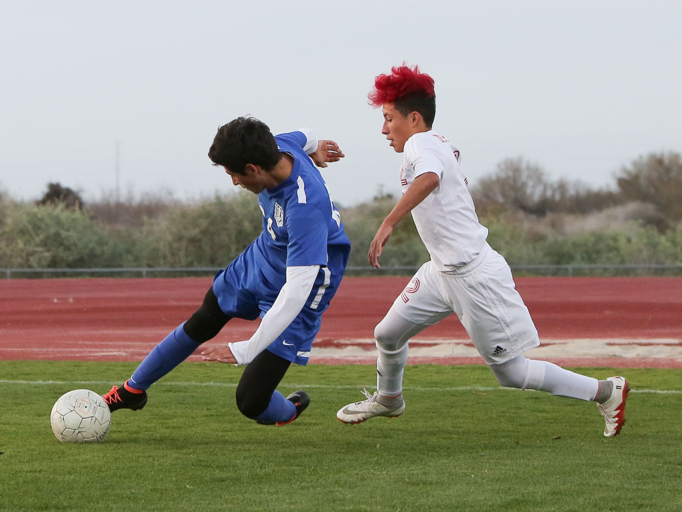 Western player steals the ball fromErick Serrano.