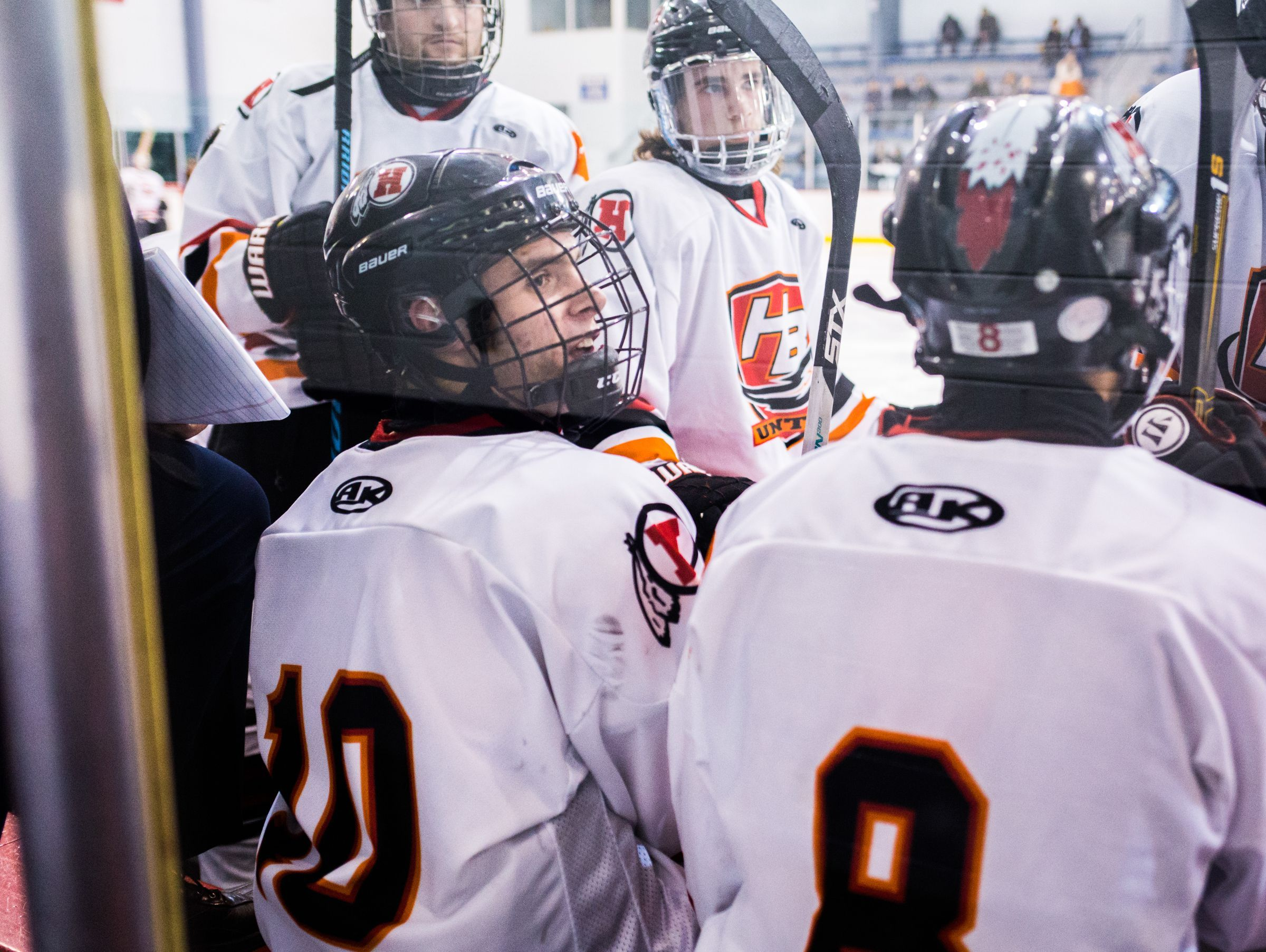 New Boston Huron's Andrew Miller (10) with his teammates near the start of the third period against Northville at Dearborn Ice Skating Center on Feb. 27, 2017.