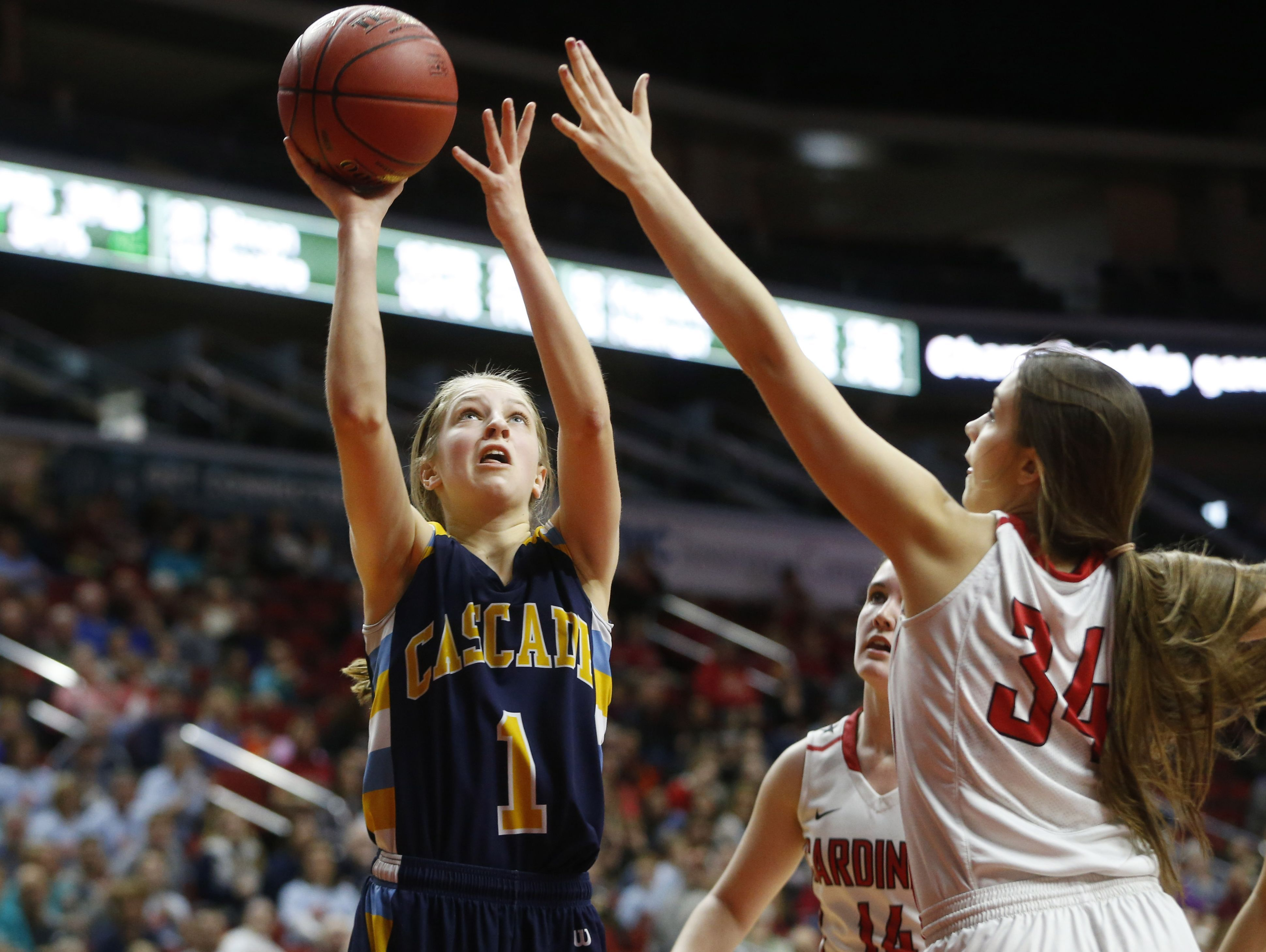 Cascade guard Nicole McDermott (1) takes a shot over Central Decatur on Tuesday, Feb. 28, 2017, during their 2A quarterfinal game at the 2017 Iowa Girls' State Basketball Tournament at Wells Fargo Arena in Des Moines.