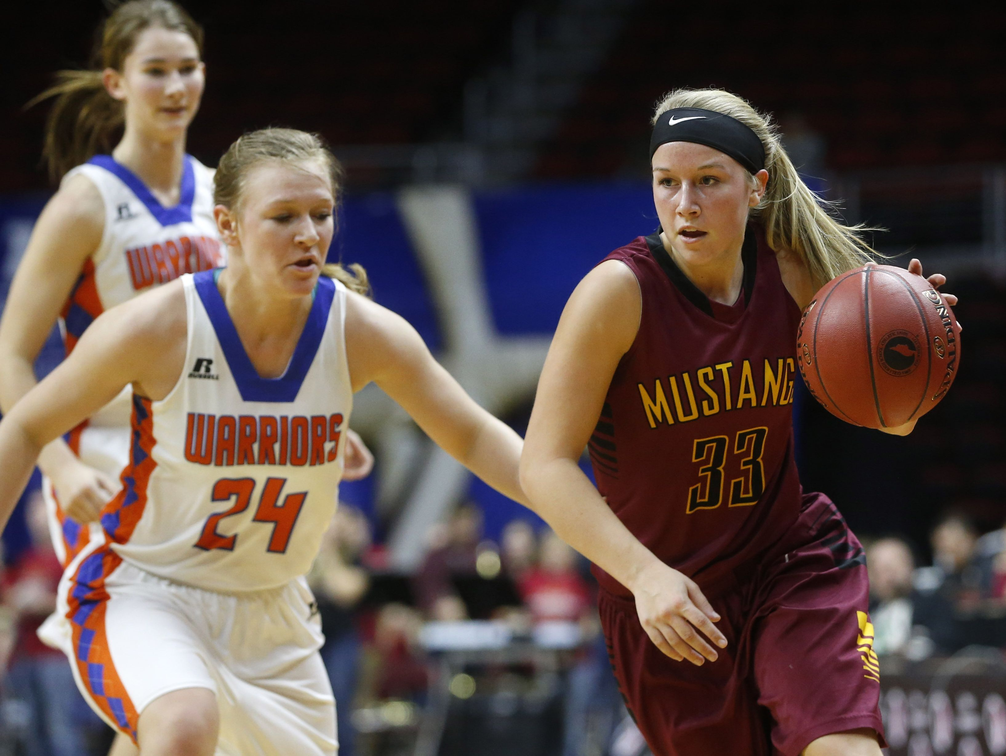 PCM senior Kayla Jennings (33) drives the ball around Sioux Center guard Shayla Post (24) on Tuesday, Feb. 28, 2017, during their 3A quarterfinal game at the 2017 Iowa Girls' State Basketball Tournament at Wells Fargo Arena in Des Moines.