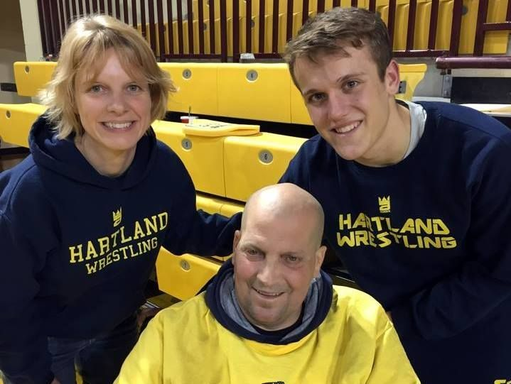 Joey Livingston (right) stands with his dad, Craig Livingston (center), and close family friend Kym Anderson after the Division 1 2016 team state title match, which the Eagles won.