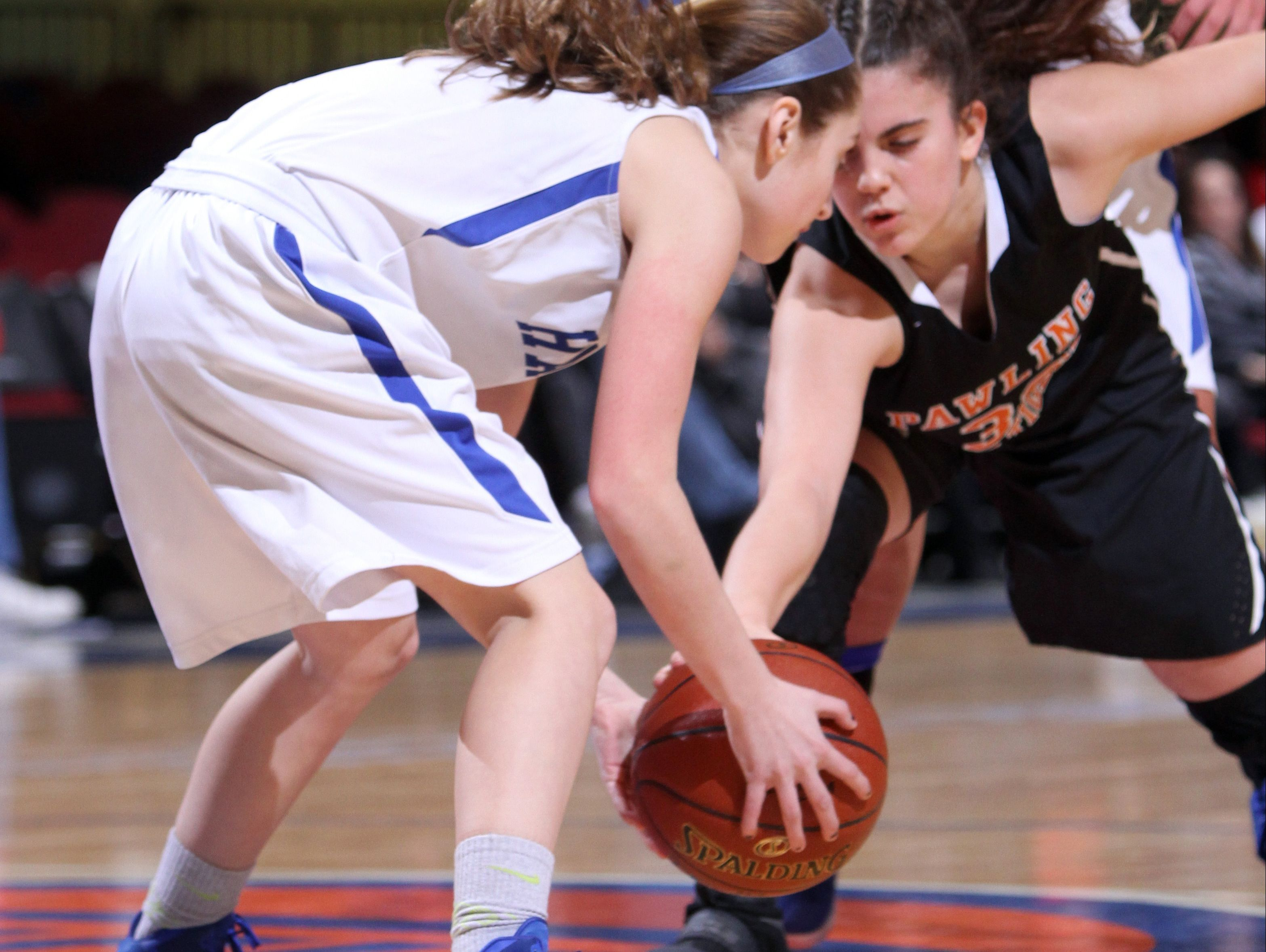 Haldane's Olivia McDermott and Pawling's Taylor Brenneman battle for the loose ball during a Section 1 Class C semifinal basketball game at the Westchester County Center Feb. 28, 2017. Haldane defeated Pawling 64-37.