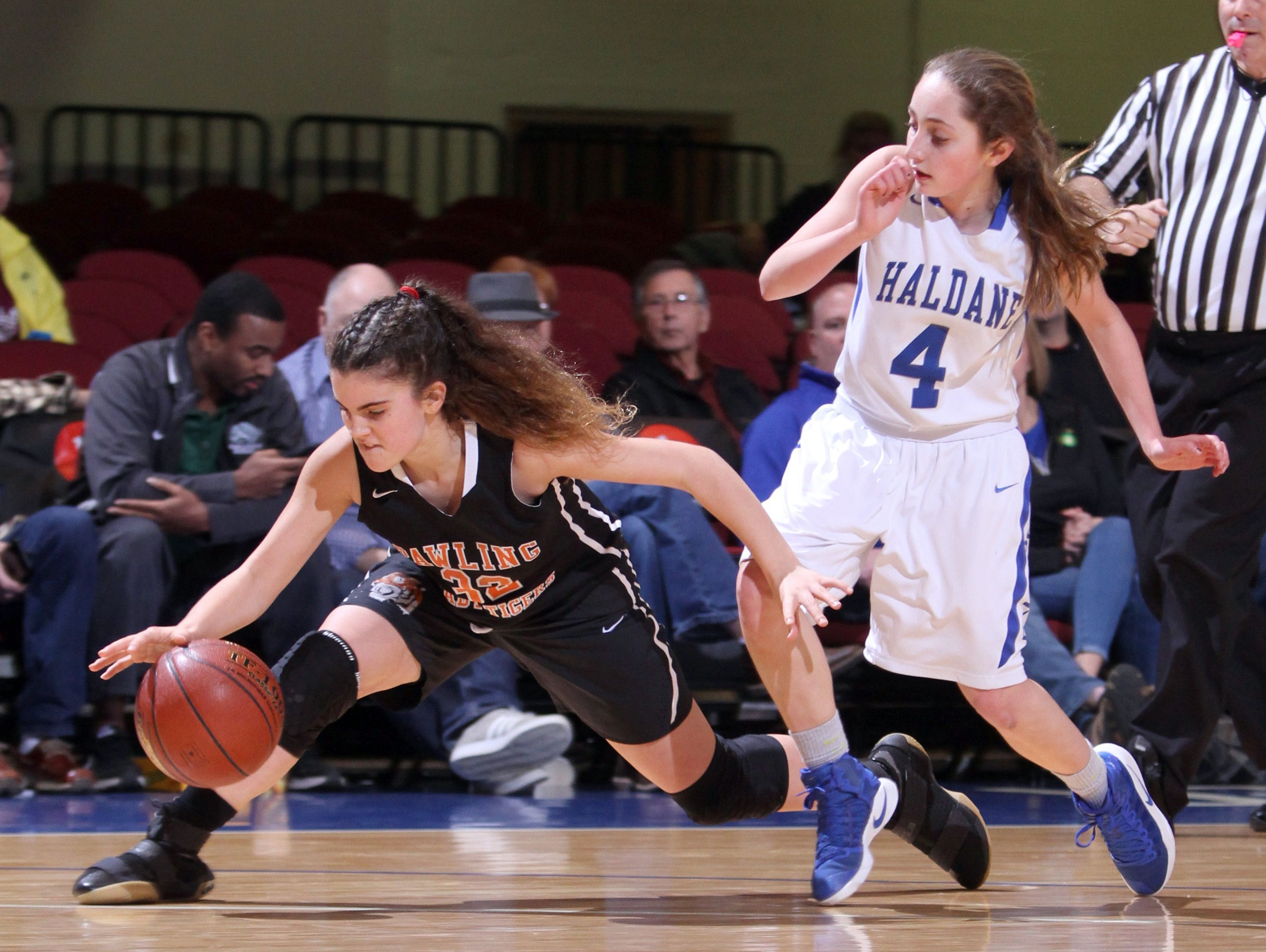 Pawling's Taylor Brenneman stretches for the loose ball as she battles Haldane's Olivia McDermott during a Section 1 Class C semifinal basketball game at the Westchester County Center Feb. 28, 2017. Haldane defeated Pawling 64-37.
