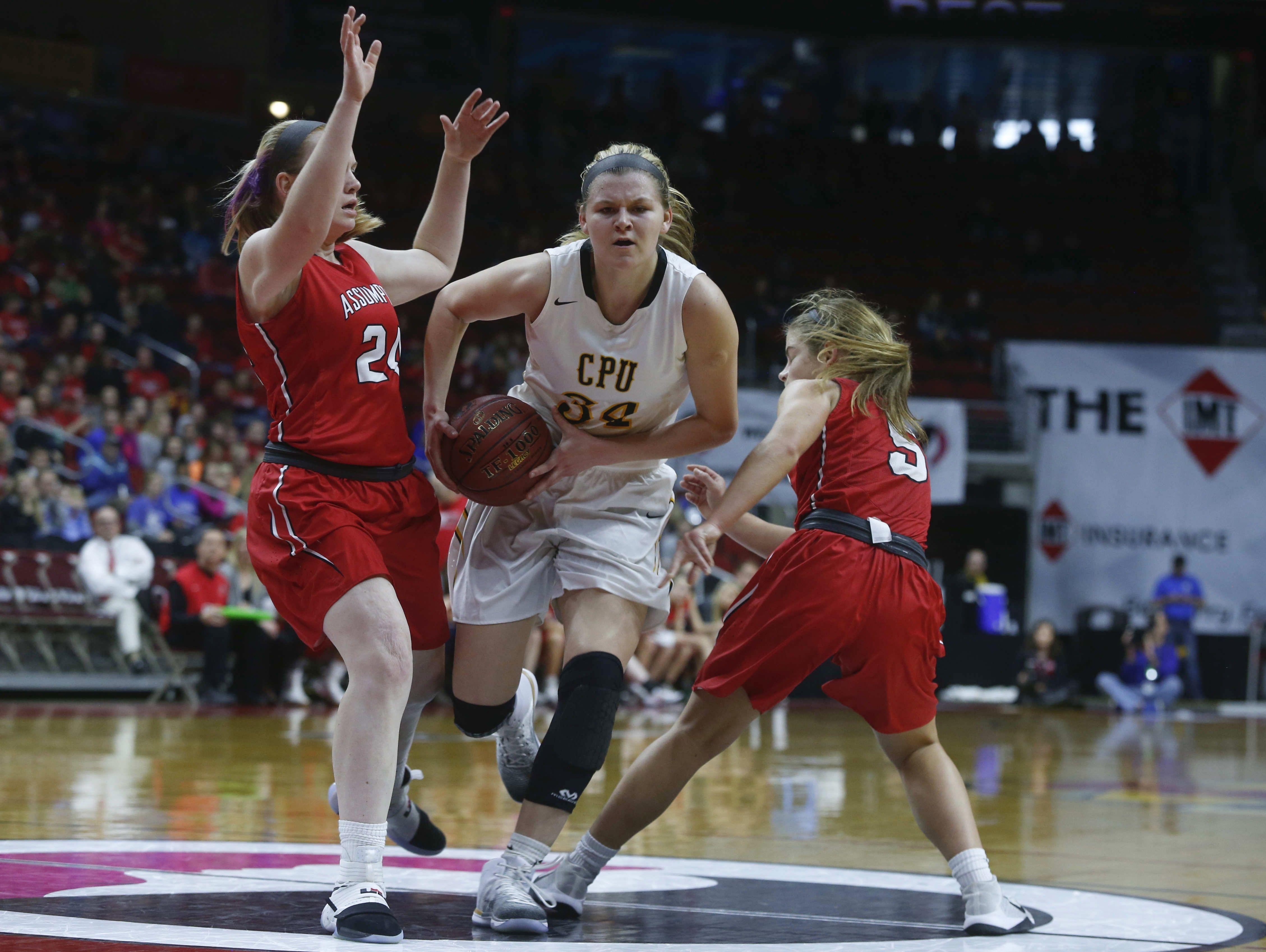 Center Point-Urbana's Allison Wooldridge drives in against Davenport Assumption on Tuesday, Feb. 28, 2017, at Wells Fargo Arena in Des Moines.