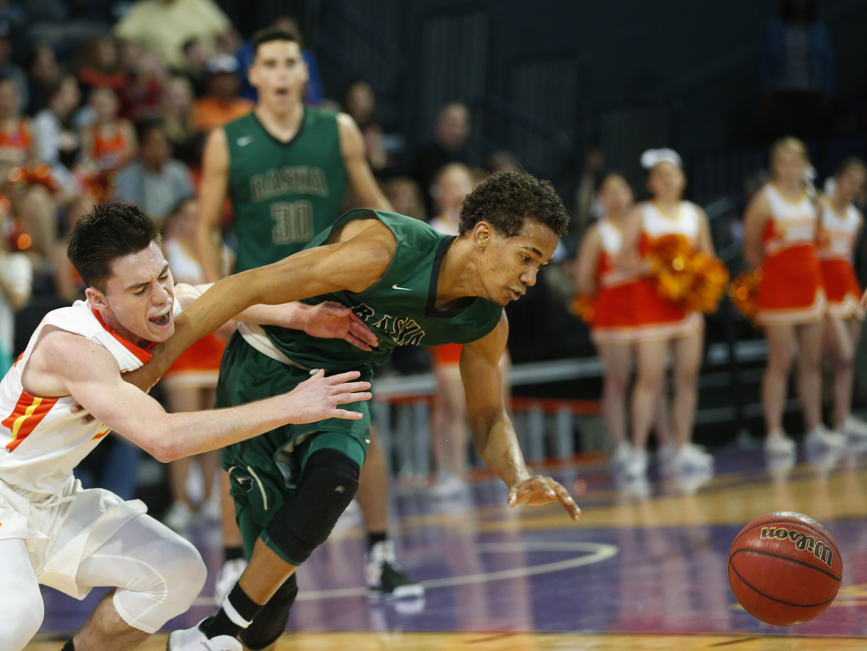Corona del Sol guard Alex Barcello (23) is fouled by Basha guard Terrell Brown (2) during the finals of the 6A Conference state championship at GCU Arena in Phoenix, Ariz. February 28, 2017.
