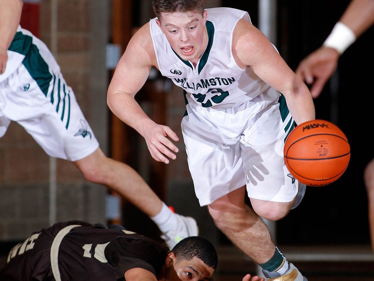Williamston's Cole Kleiver gets a steal against Holt's Myles Baker, bottom, Feb. 28, in Williamston, Mich. Holt won 69-52.