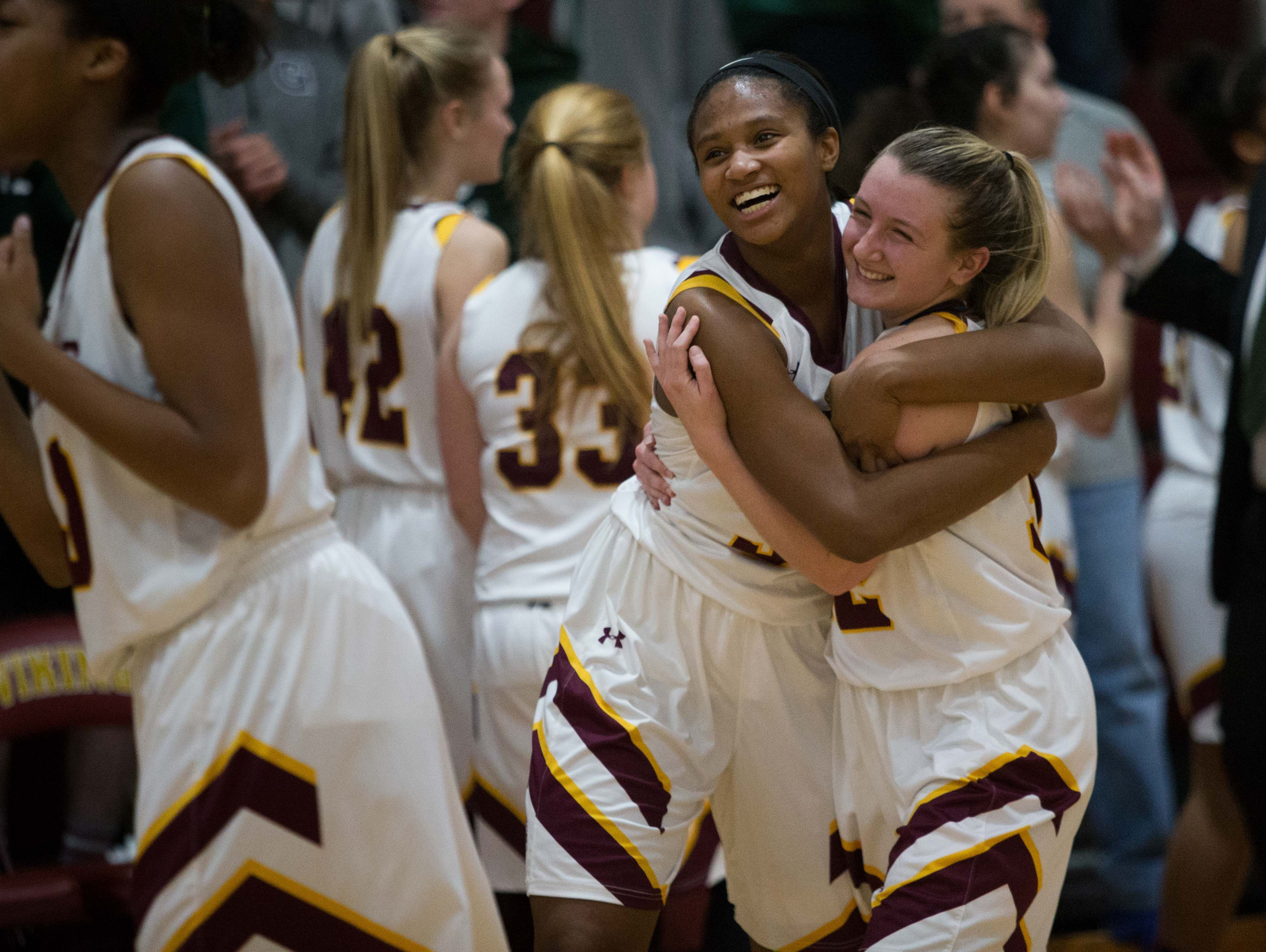 Alanna Speaks, left, and Alexis Bromwell celebrate after their second round playoff win. St. Elizabeth defeats Archmere 49-42 in the second round of the DIAA state girls basketball tournament at St. Elizabeth Thursday.