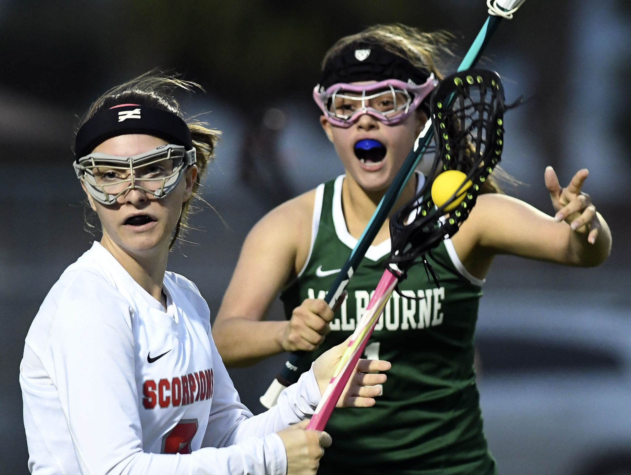 Melbourne's Meredith Markos chases Jasmine Rogell of Satellite during Thursday's games.