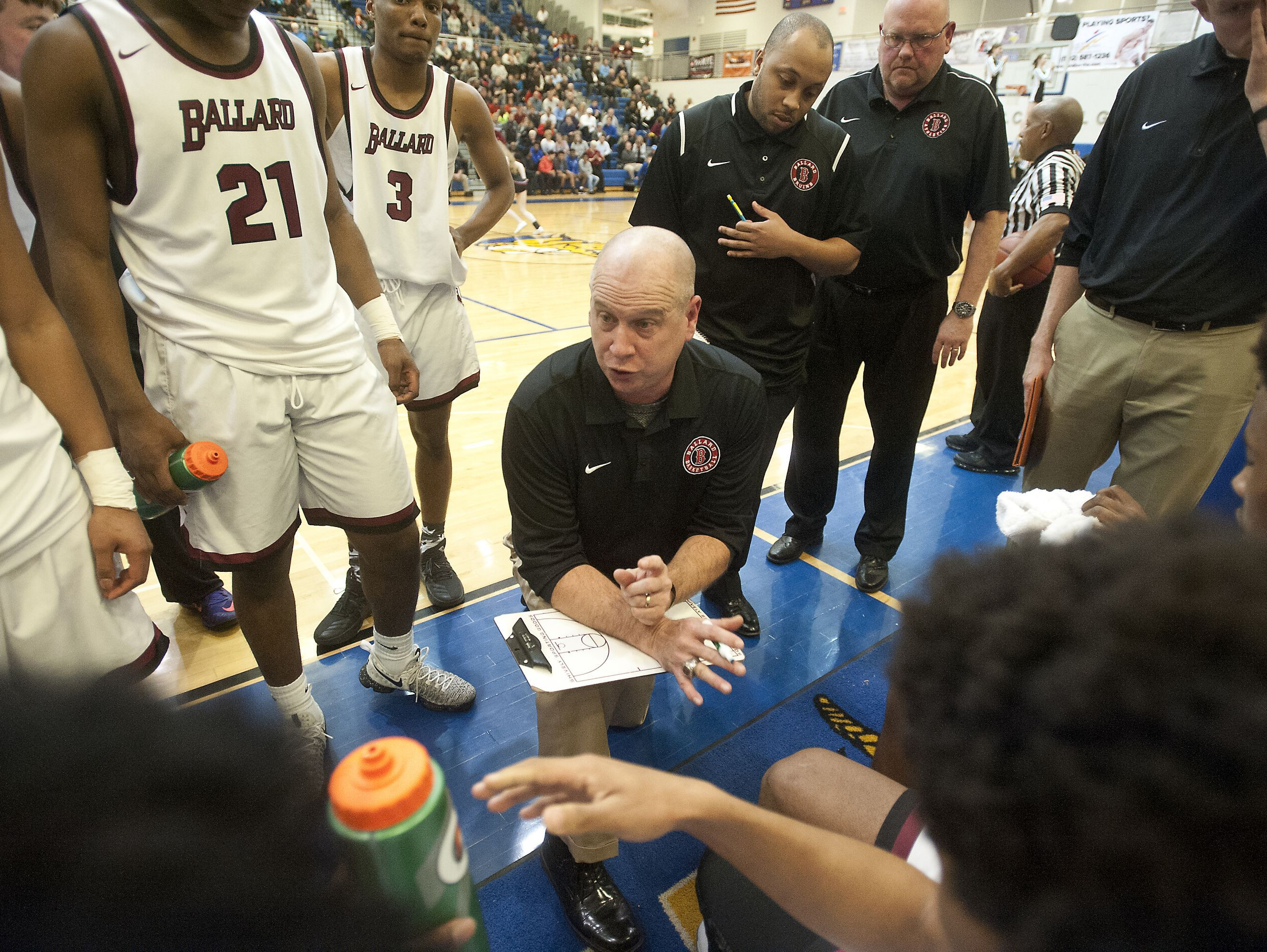 Ballard head basketball coach Chris C. Renner talks to his players during a time-out in the KHSAA boys 7th regional basketball semifinals. 02 March 2017