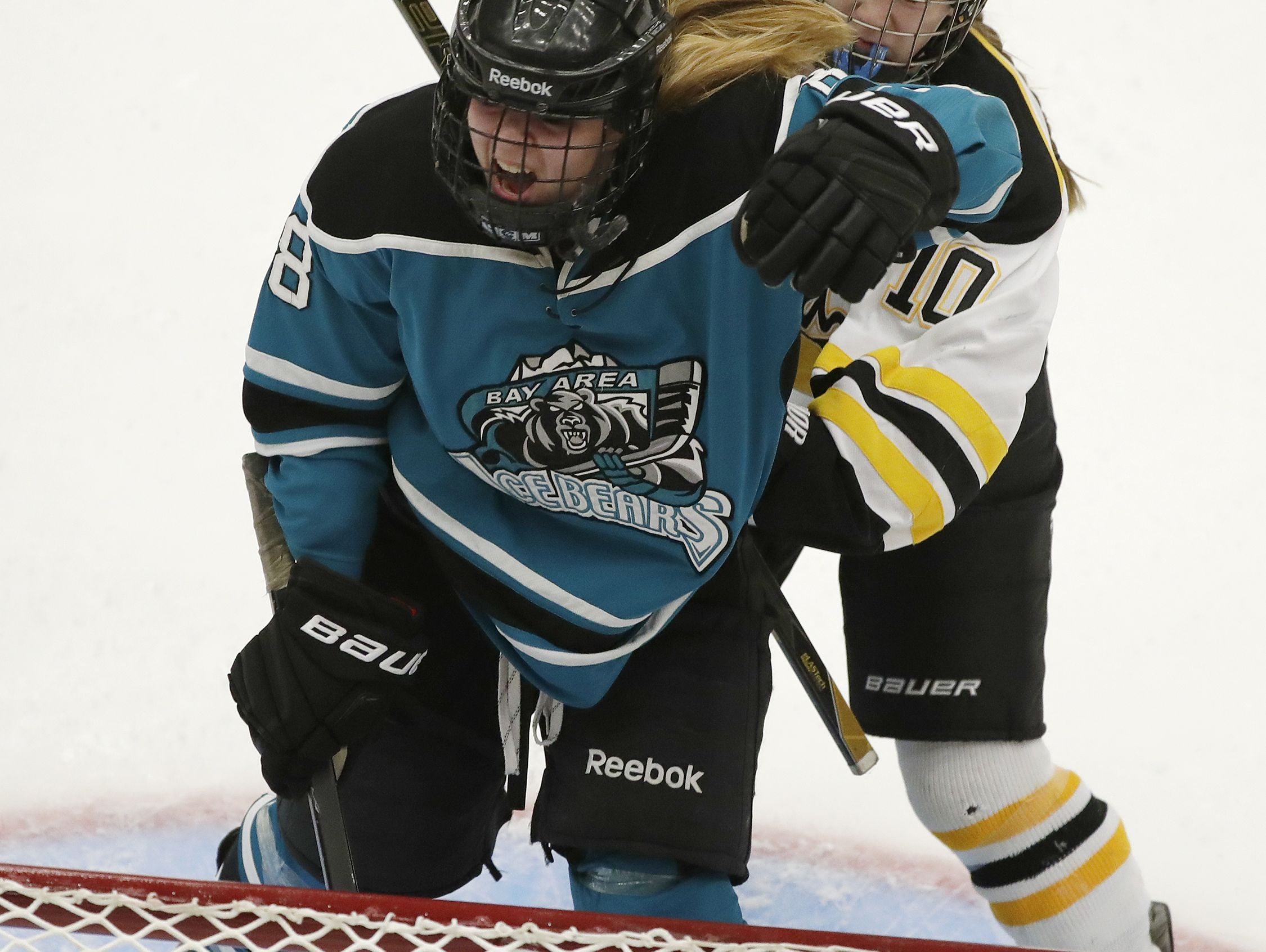 Bay Area Ice Bears forward Megan Saari (8) celebrates after scoring in the 3rd period against the Hayward Hurricanes during a girls semifinal match at the WIAA state hockey tournament on Friday at the Alliant Energy Center.