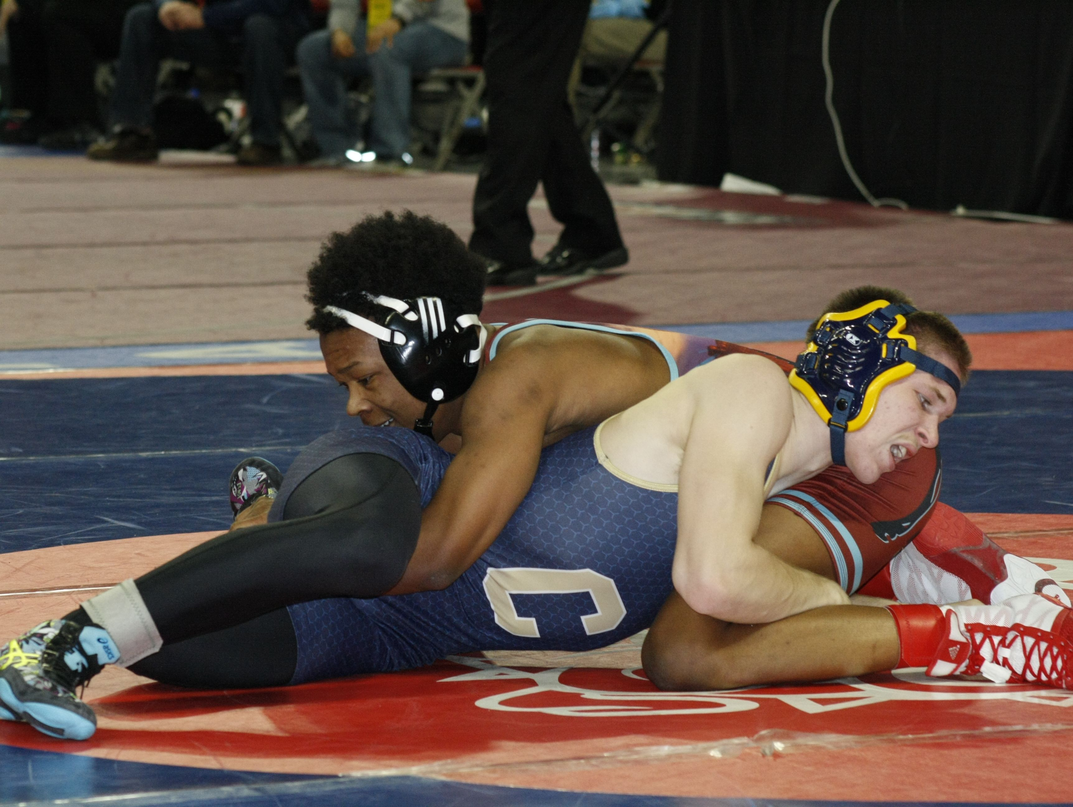 Kemonte Simons of Mumford, top, beat Chelsea's Nick Matusko, 14-8, in Division 2 quarterfinals at 125 pounds Friday.