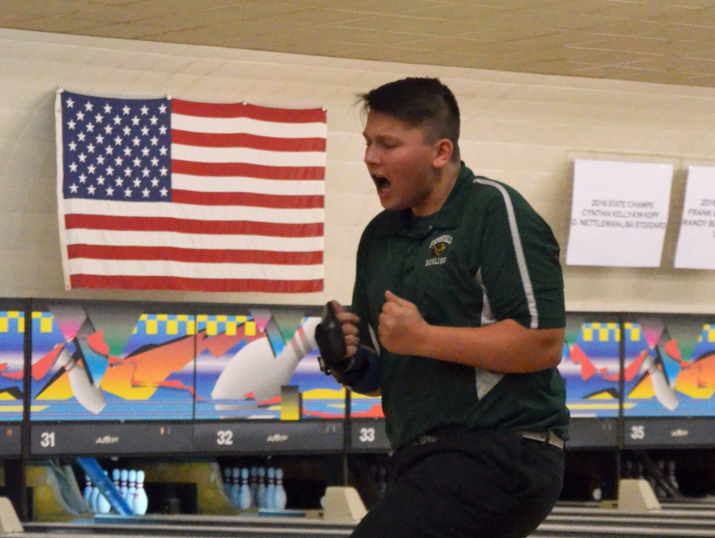 Pennfield junior Joe Larsen reacts following a strike during the 2017 MHSAA Division 3 Boys Bowling State Championships on Friday at M-66 Bowl in Battle Creek.