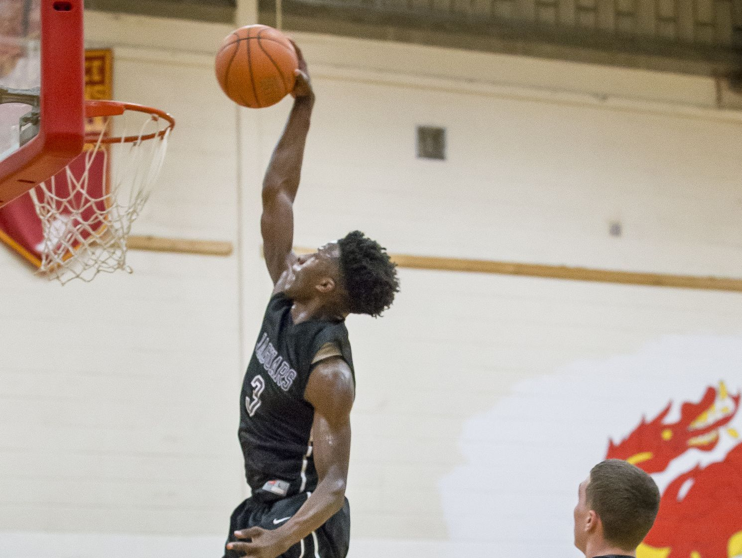 Appoquinimink's Myles Cale, seen here against Glasgow, scored 20 points along with teammate Travis Holmes as the Jaguars defeated Newark in DIAA playoff action.