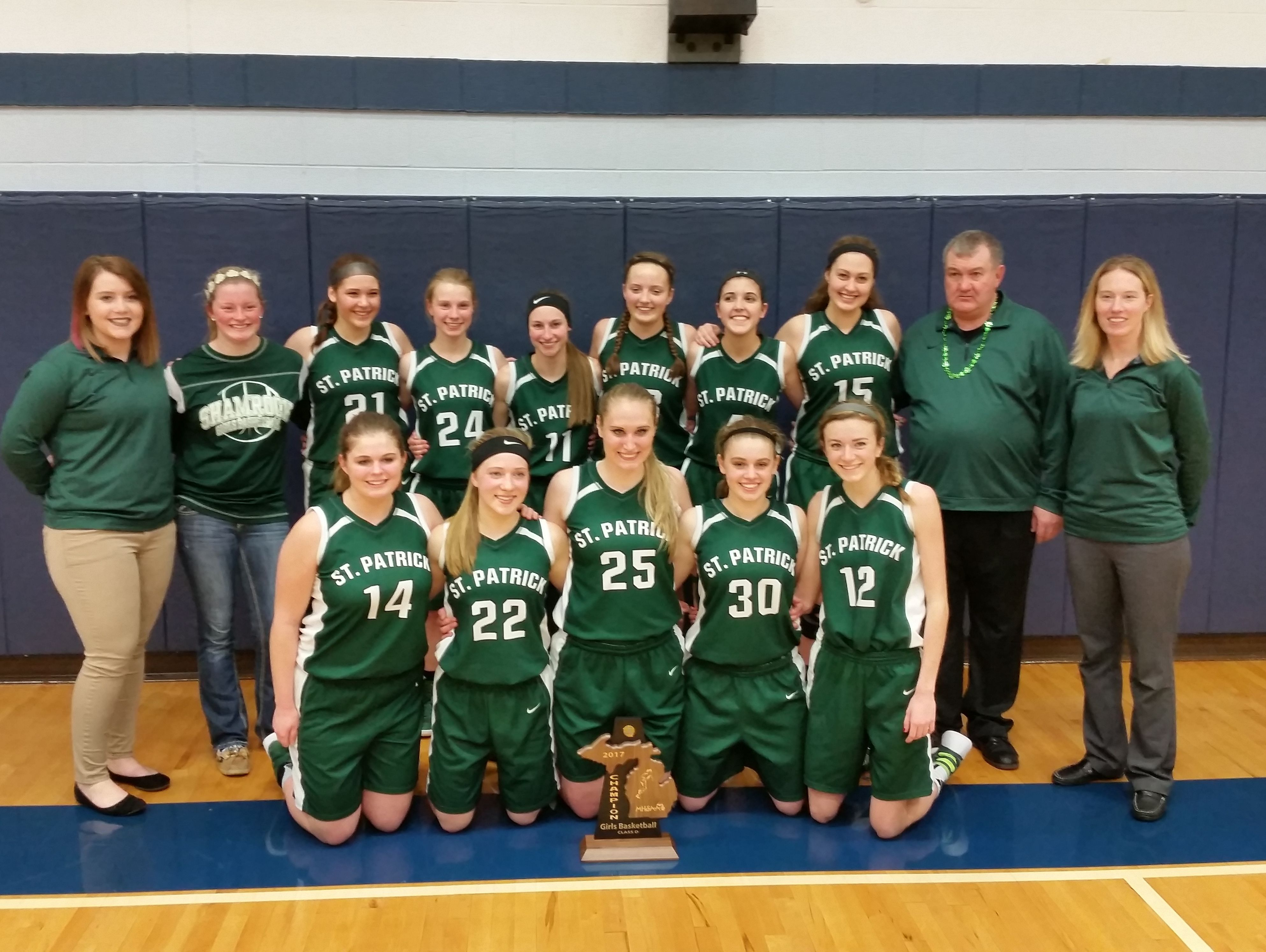 The Portland St. Patrick girls basketball team poses with its district championship trophy Friday. The Shamrocks are among the area teams competing in regionals next week.