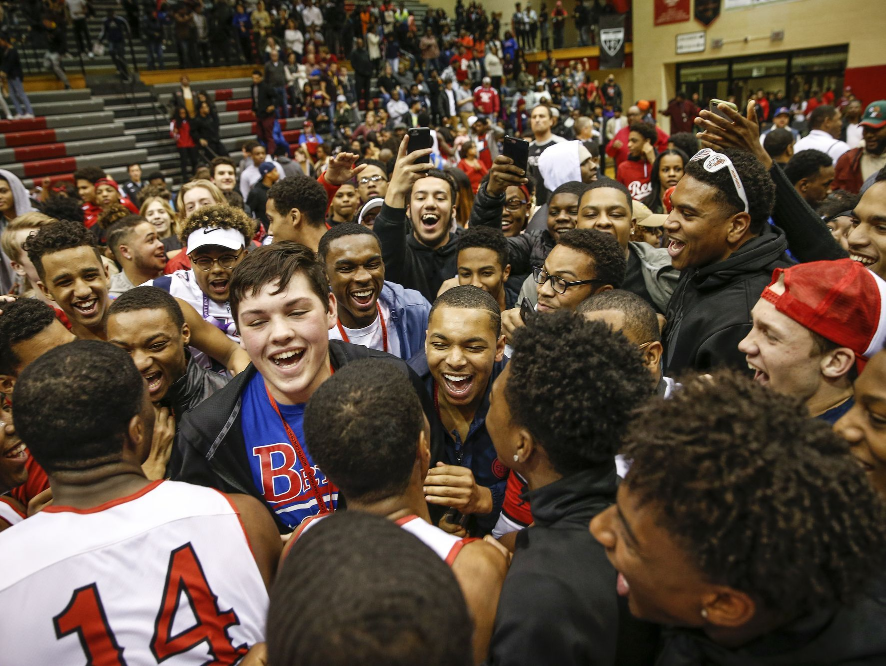North Central Panthers players and fans celebrate after the Panthers' win over the Lawrence North Wildcats in their IHSAA 4A sectional final basketball game at North Central High School on Saturday, March 4, 2017.