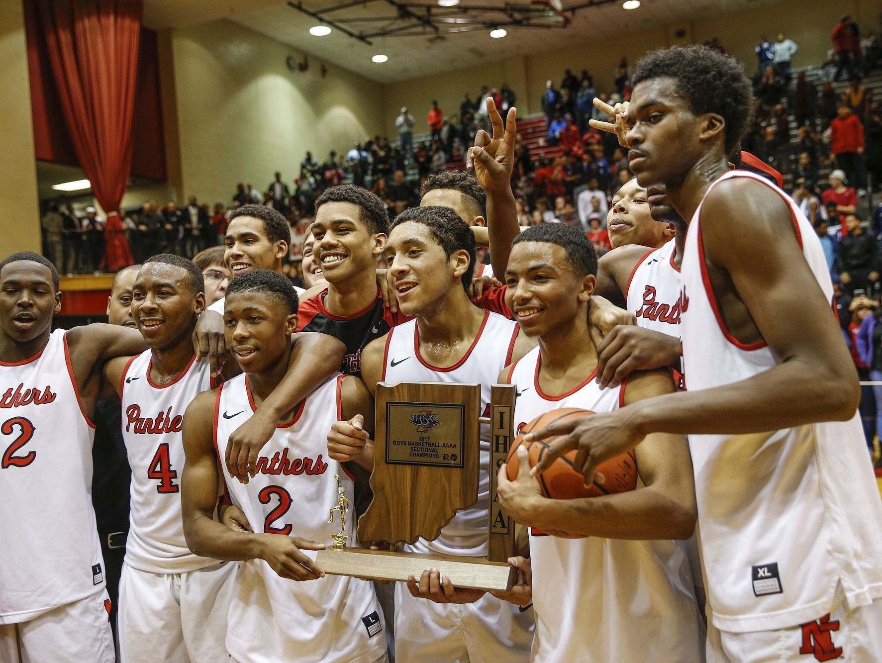 The North Central Panthers pose for a photo after defeating the Lawrence North Wildcats in their IHSAA 4A sectional final basketball game at North Central High School on Saturday, March 4, 2017.