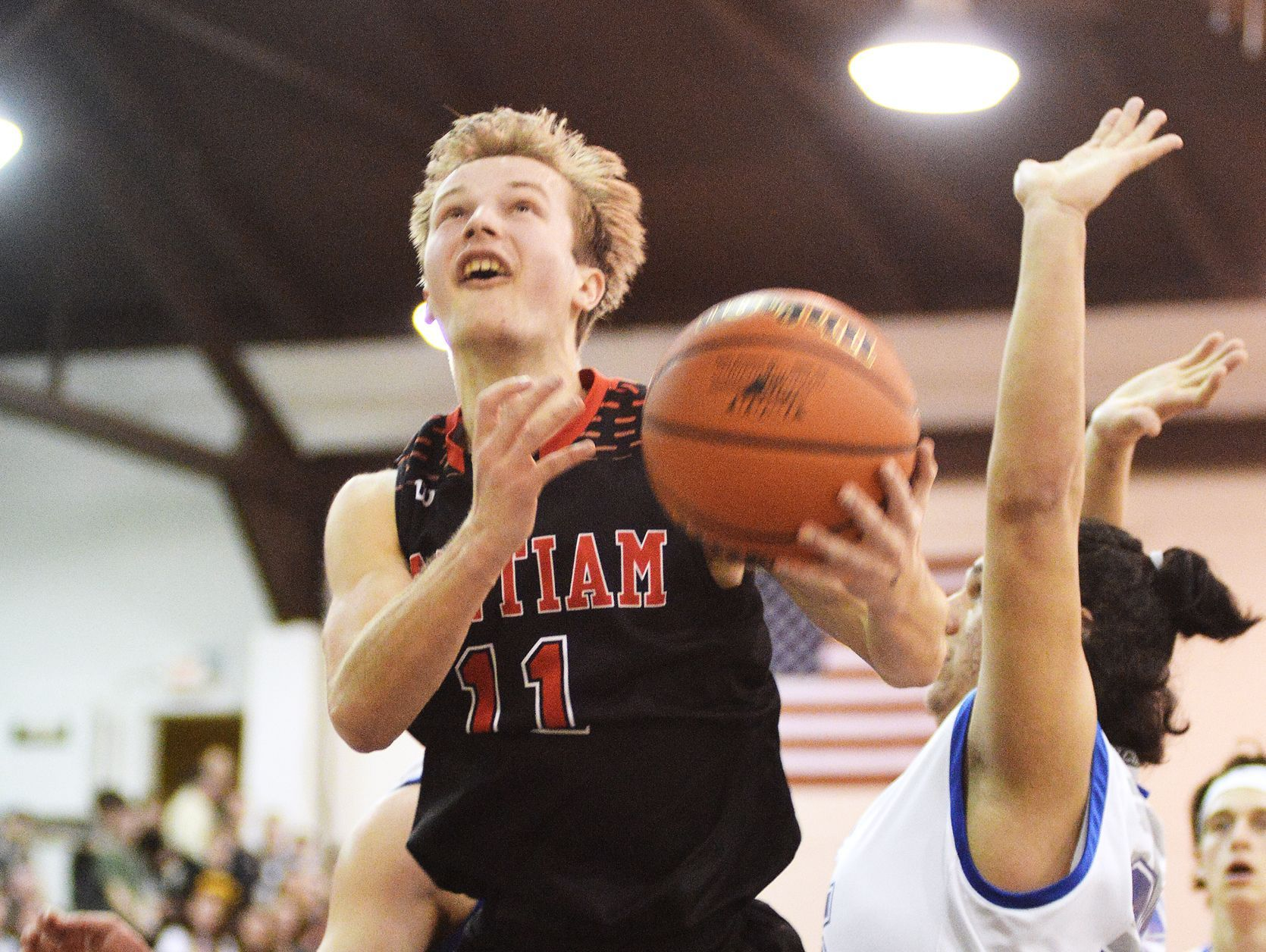 Santiam's Julian Downey splits Stanfield defenders Ryan Bailey and Jose Garcia in the Wolverines' 57-54 win over the Tigers in the state 2A basketball championship game on Saturday in Pendleton.