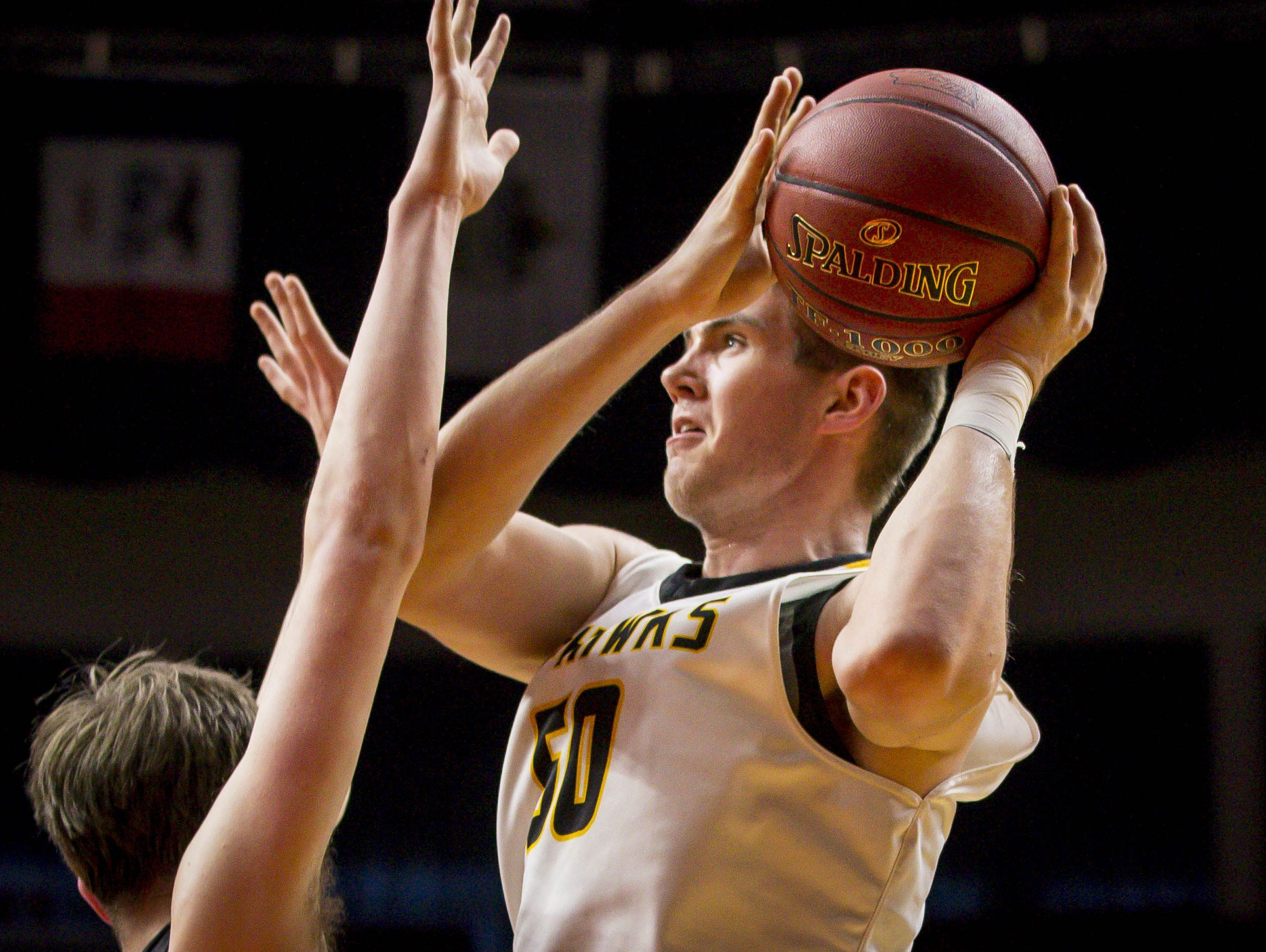 Waverly-Shell Rock's (50) Austin Phyfe shoots over an Atlantic defender during their 3A quarterfinal matchup at the Iowa boys' state basketball tournament at Wells Fargo Arena Tuesday March 7, 2017, in Des Moines, Iowa.