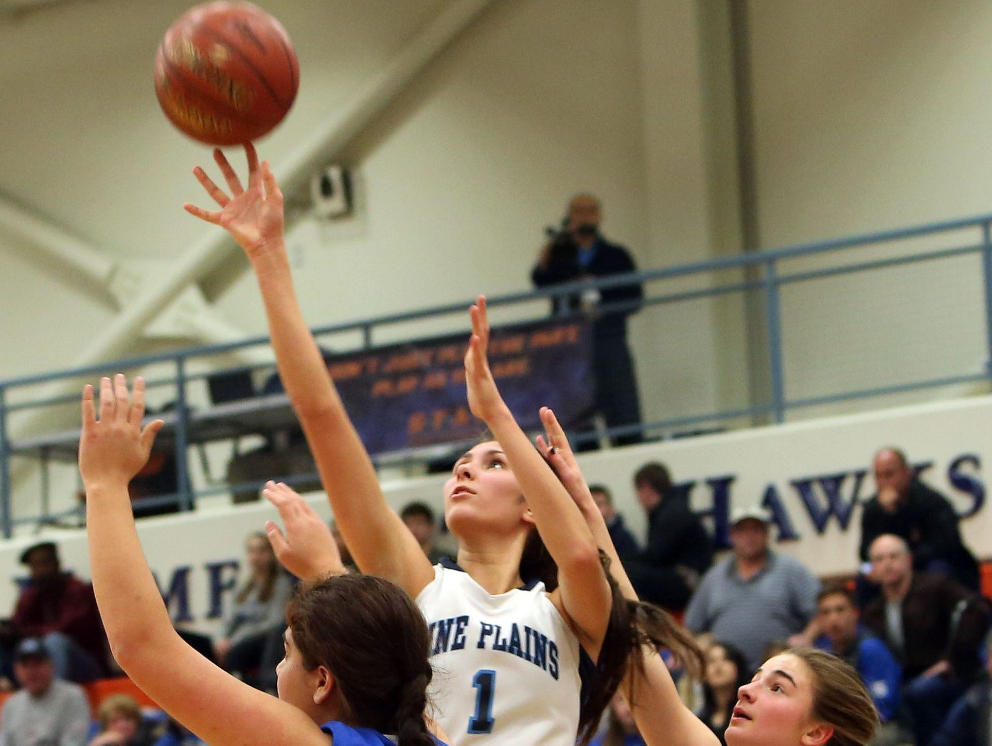 Pine Plains' Ashley Starzyk (1) puts up a shot in front of Haldane's Gabriele Bauman (31) during the state regional semifinal at SUNY New Paltz March 7, 2017.