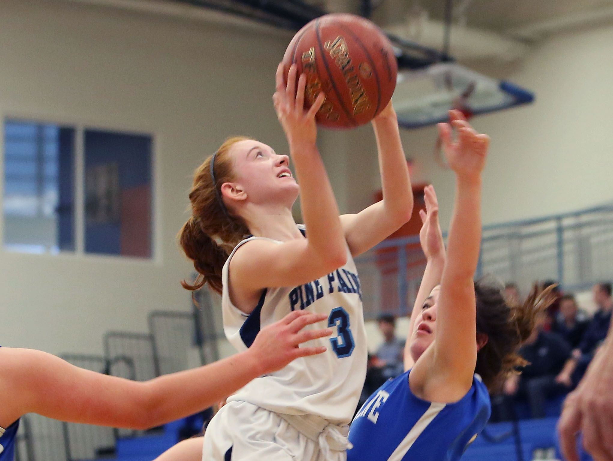 From left, Pine Plains' Frances Snyder (3) drives to the basket in front of Haldane's Hannah Monteleone (3) during the state regional semifinal at SUNY New Paltz March 7, 2017.
