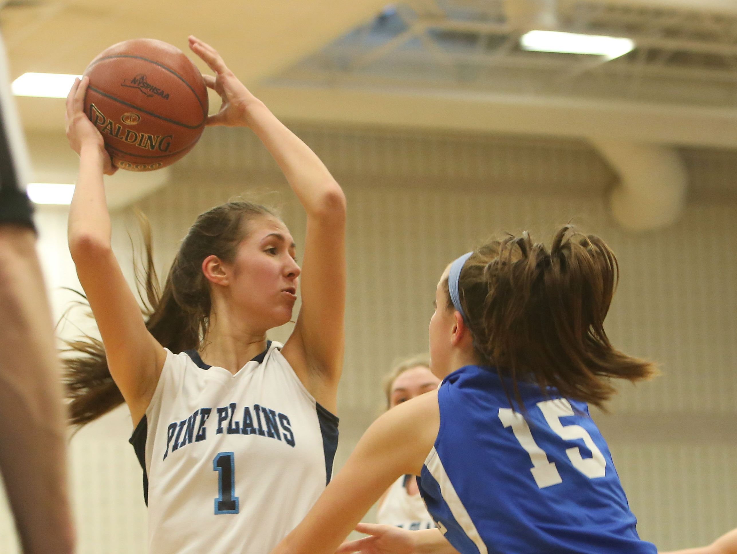 Pine Plains' Ashley Starzyk (1) looks for an open teammate while guarded by Haldane's Olivia Monteleone (15) during the state regional semifinal at SUNY New Paltz March 7, 2017.