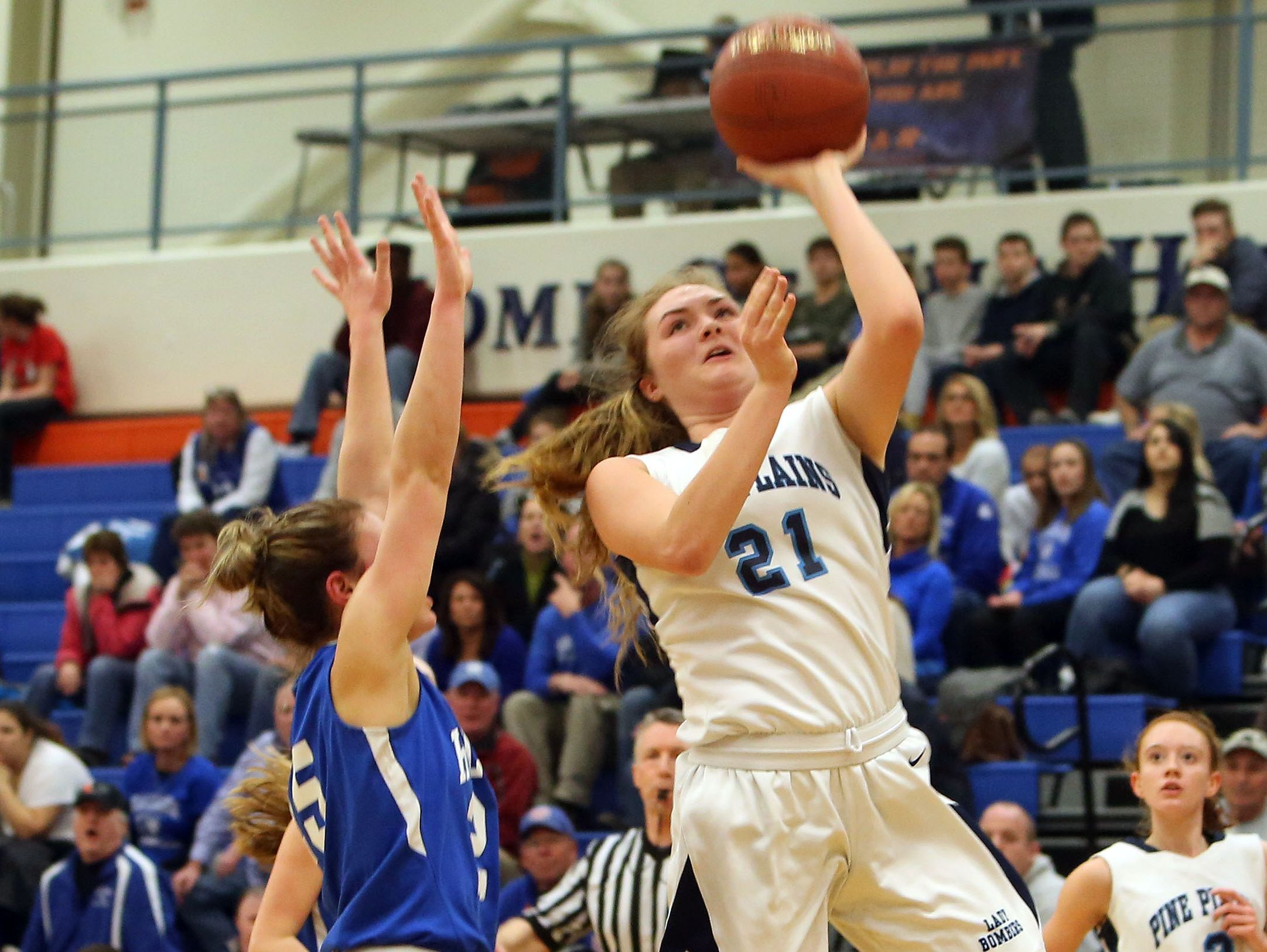 Pine Plains' Isabella Starzyk (21) goes up for a shot in front of Haldane's Abbey Stowell (25) during the state regional semifinal at SUNY New Paltz March 7, 2017.
