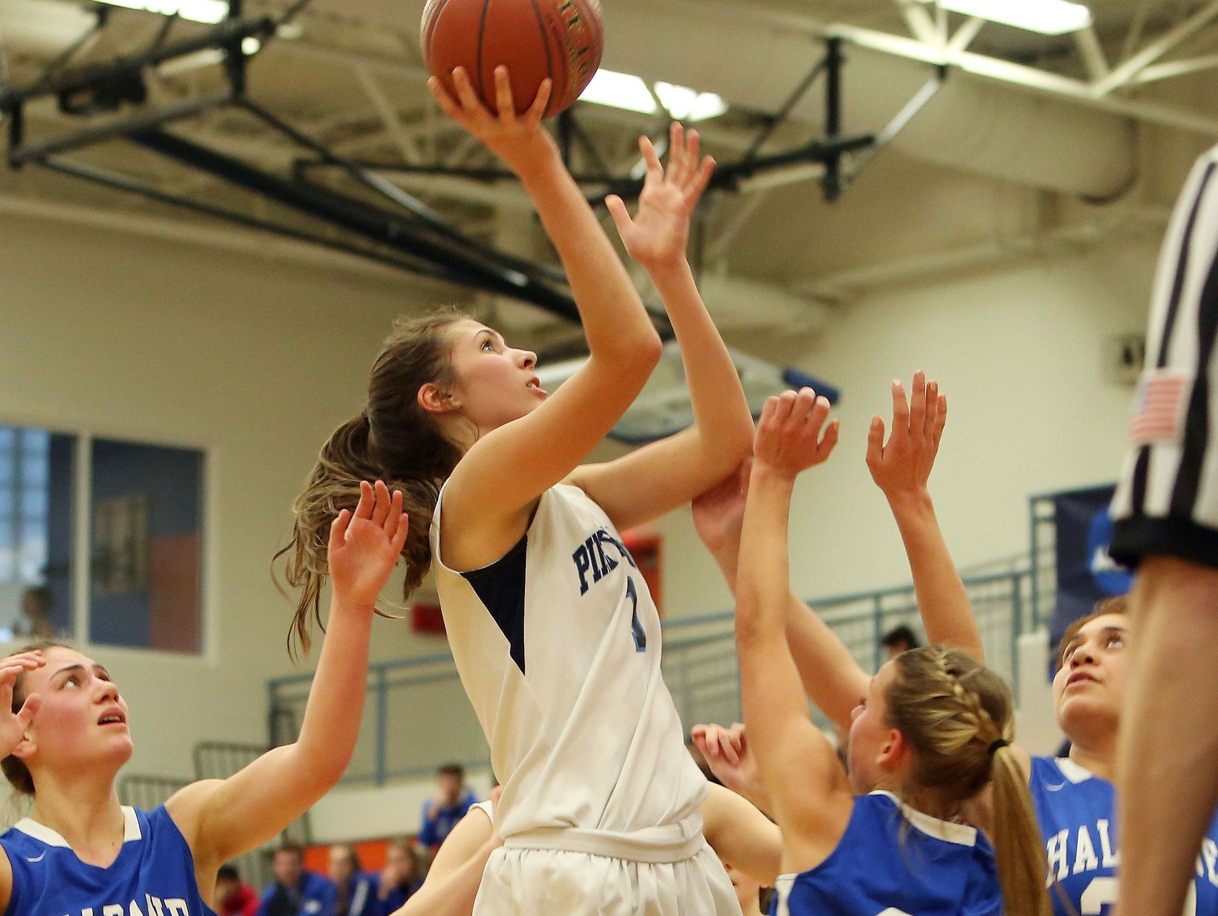 Pine Plains' Ashley Starzyk (1) is surrounded by Haldane defenders as she puts up a shot during the state regional semifinal at SUNY New Paltz March 7, 2017.