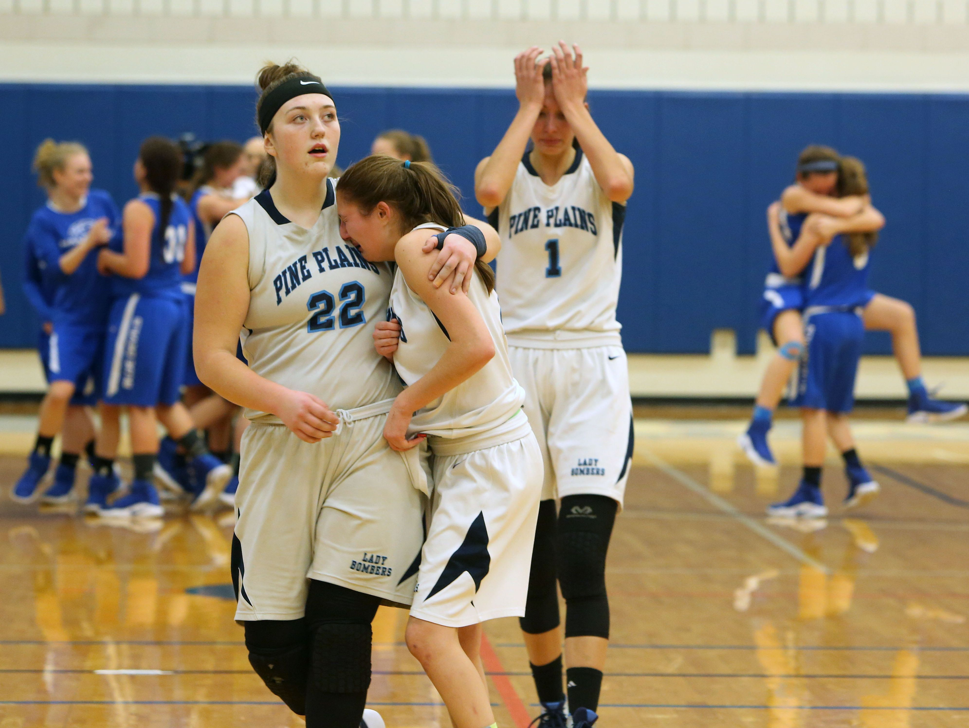 Pine Plains players walk off the court after they were defeated by Haldane 47-41 in the state regional semifinal at SUNY New Paltz March 7, 2017.