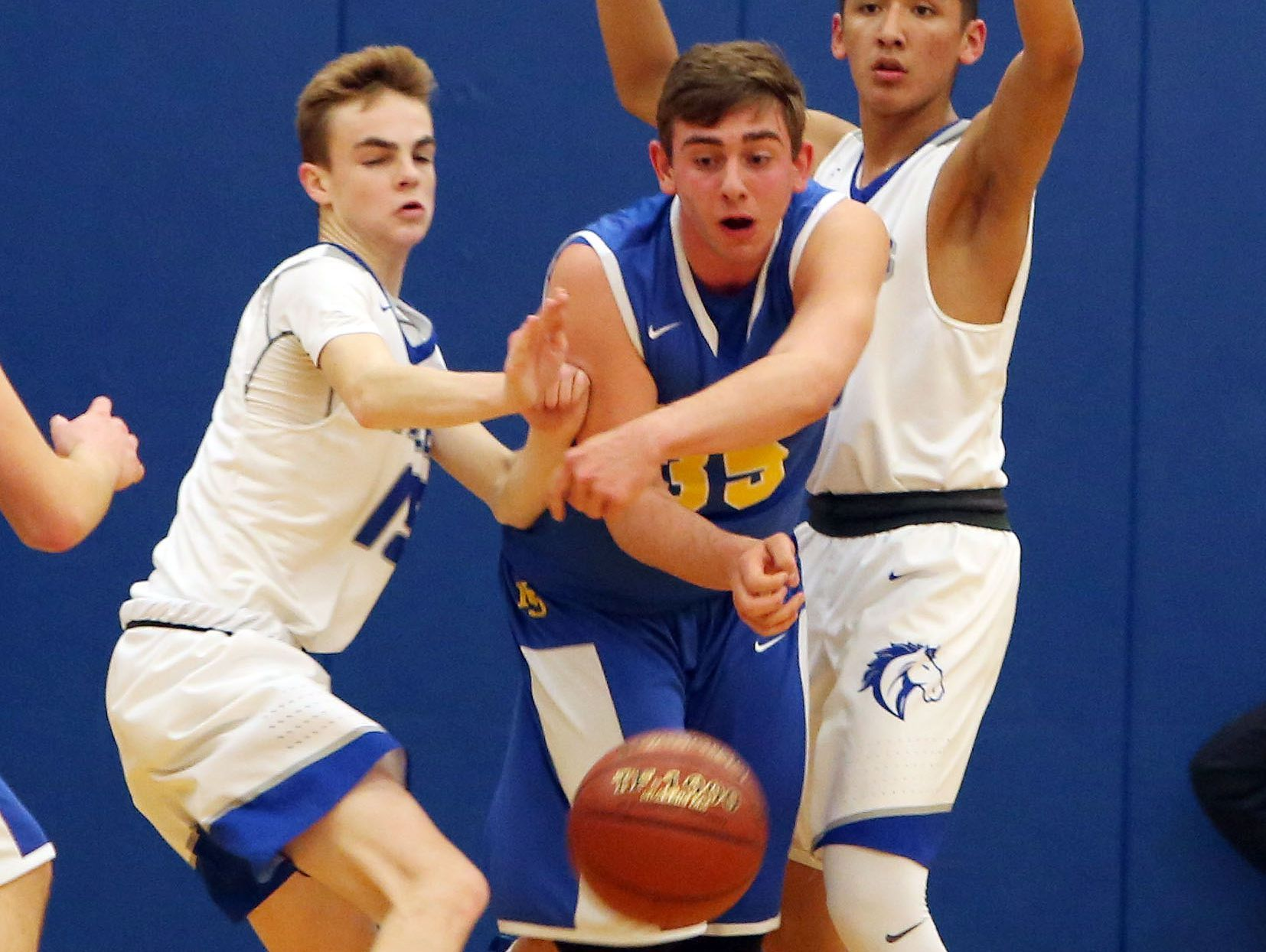 From left, Millbrook's Shane Sinon (15) and Humberto Cabrera (3) put pressure on North Salem's Chris Alterio (23) during basketball action during the state regional semifinal at SUNY New Paltz March 7, 2017.
