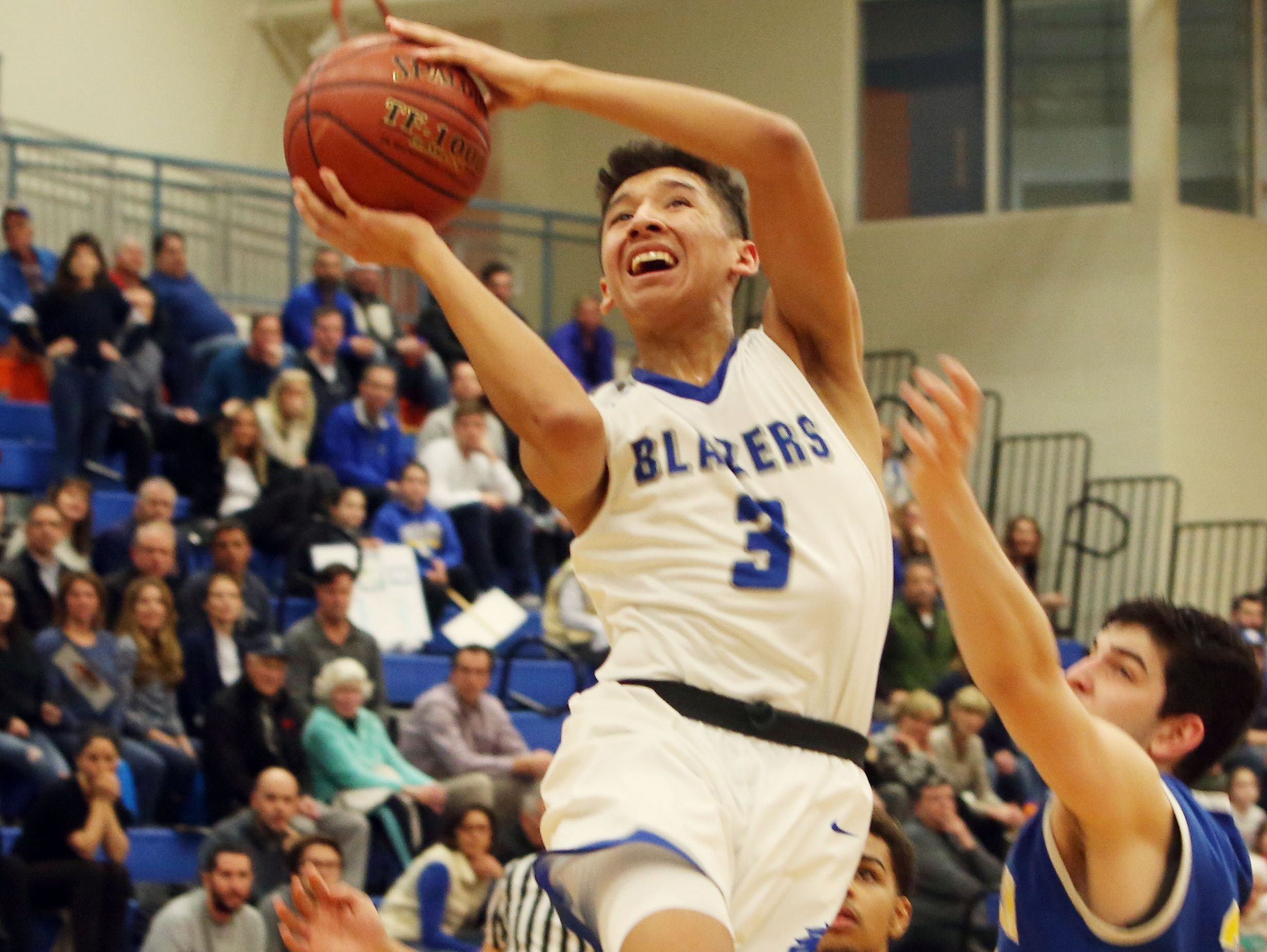 Millbrook High School's Humberto Cabrera drives to the basket against North Salem during a state regional semifinal at SUNY New Paltz on Tuesday.