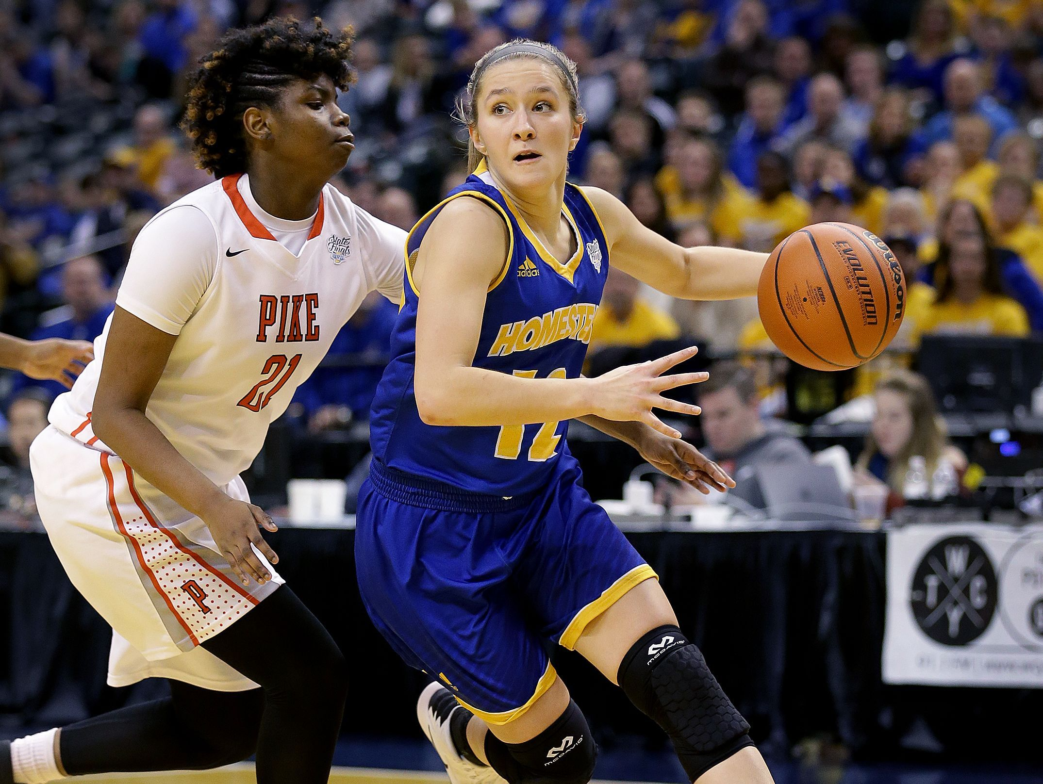 Homestead's Karissa McLaughlin (12) drives in the second half of their IHSAA 4A Girls Basketball State Finals game Feb. 25, 2017.