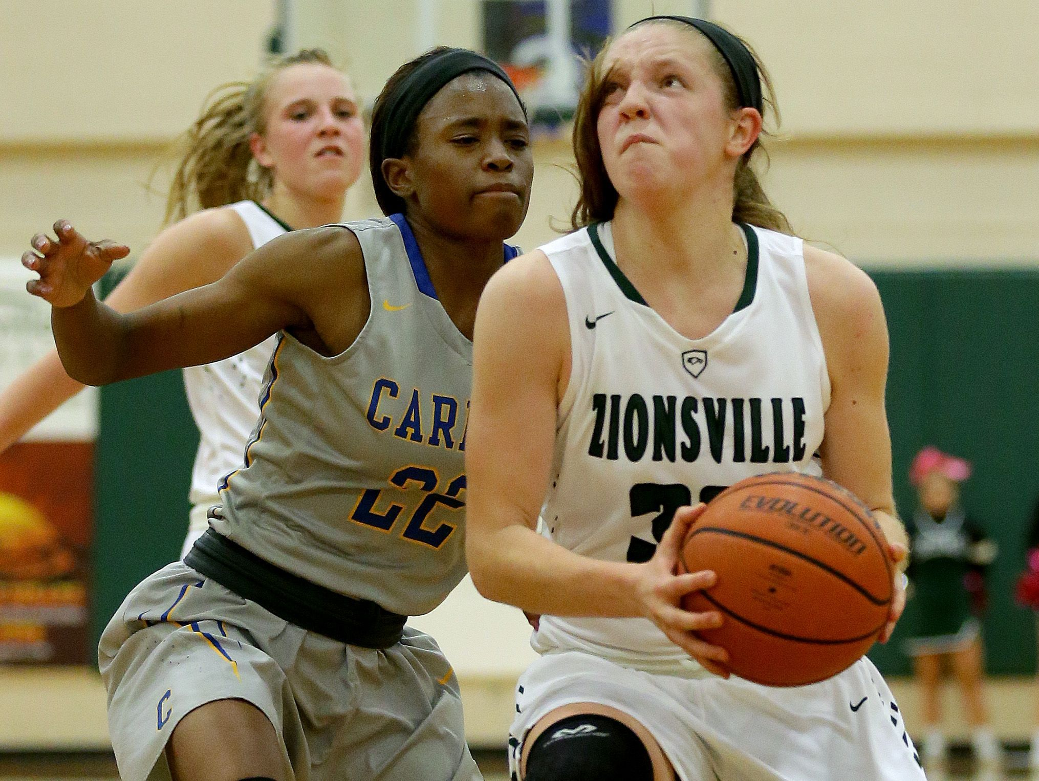 Zionsville's Rachel McLimore (32) drives to the basket around against Carmel, Nov. 15, 2016.