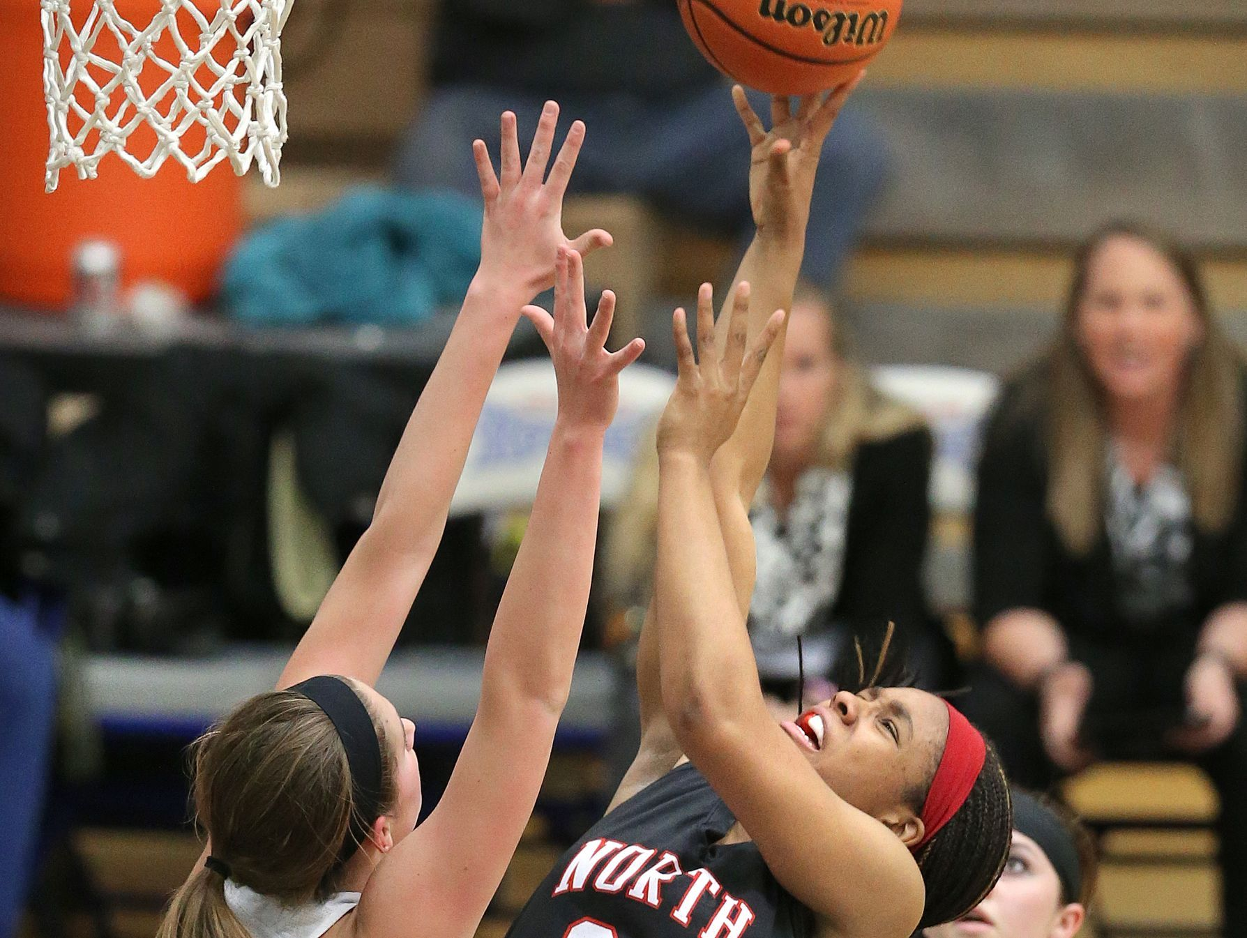 Noblesville's Emily Kiser tries to block the shot of North Central's Ajanae' Thomas in the first half of the 2015 IHSAA Girls Basketball Sectional game held at Hamilton Southeastern High School on Friday, Feb. 13, 2015. Noblesville beat North Central 68-39.