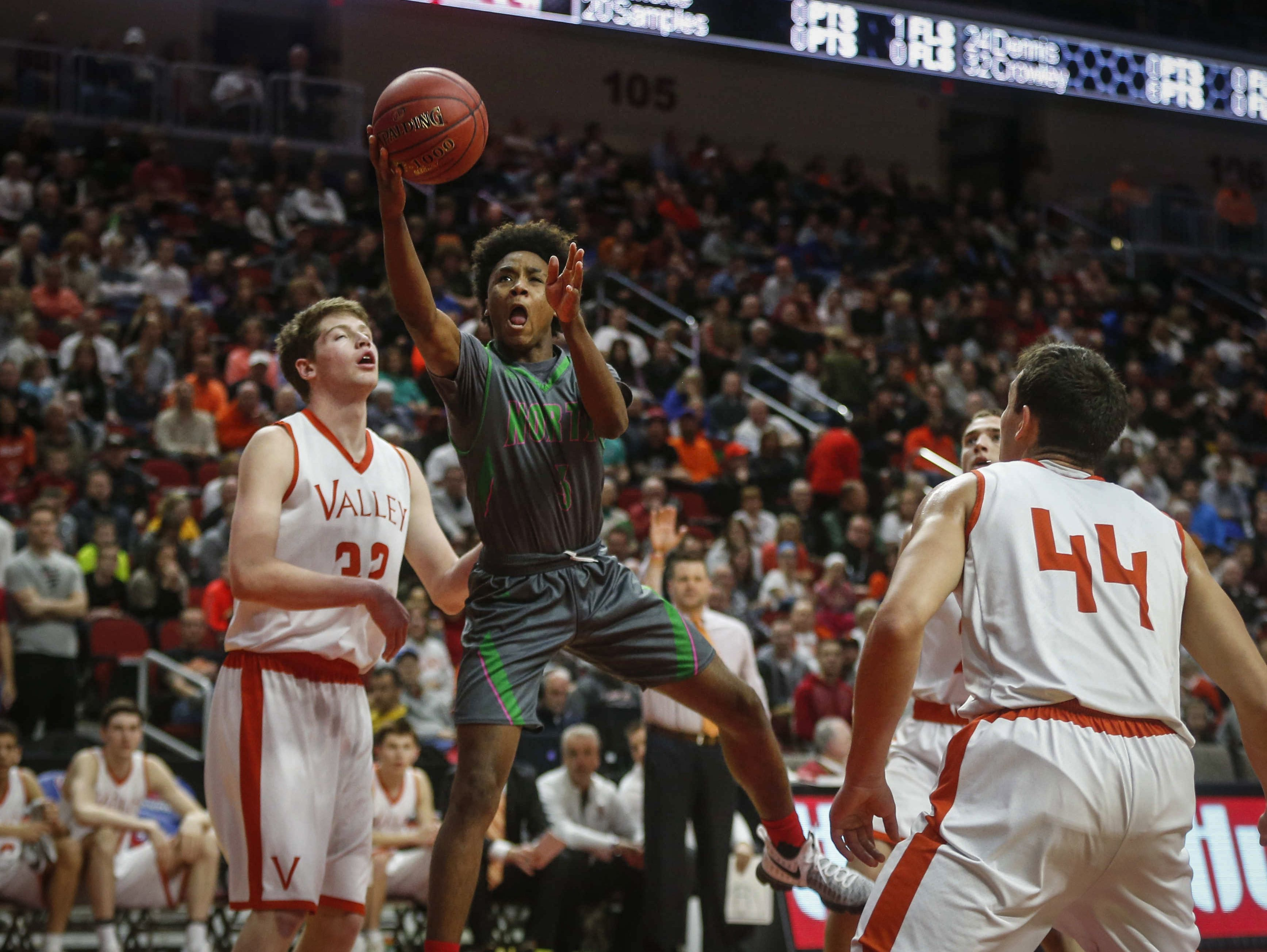 Des Moines North sophomore Tyreke Locure runs the ball up to the hoop against Valley during the Iowa High School state basketball tournament at Wells Fargo Arena in Des Moines on Wednesday, March 8, 2017.