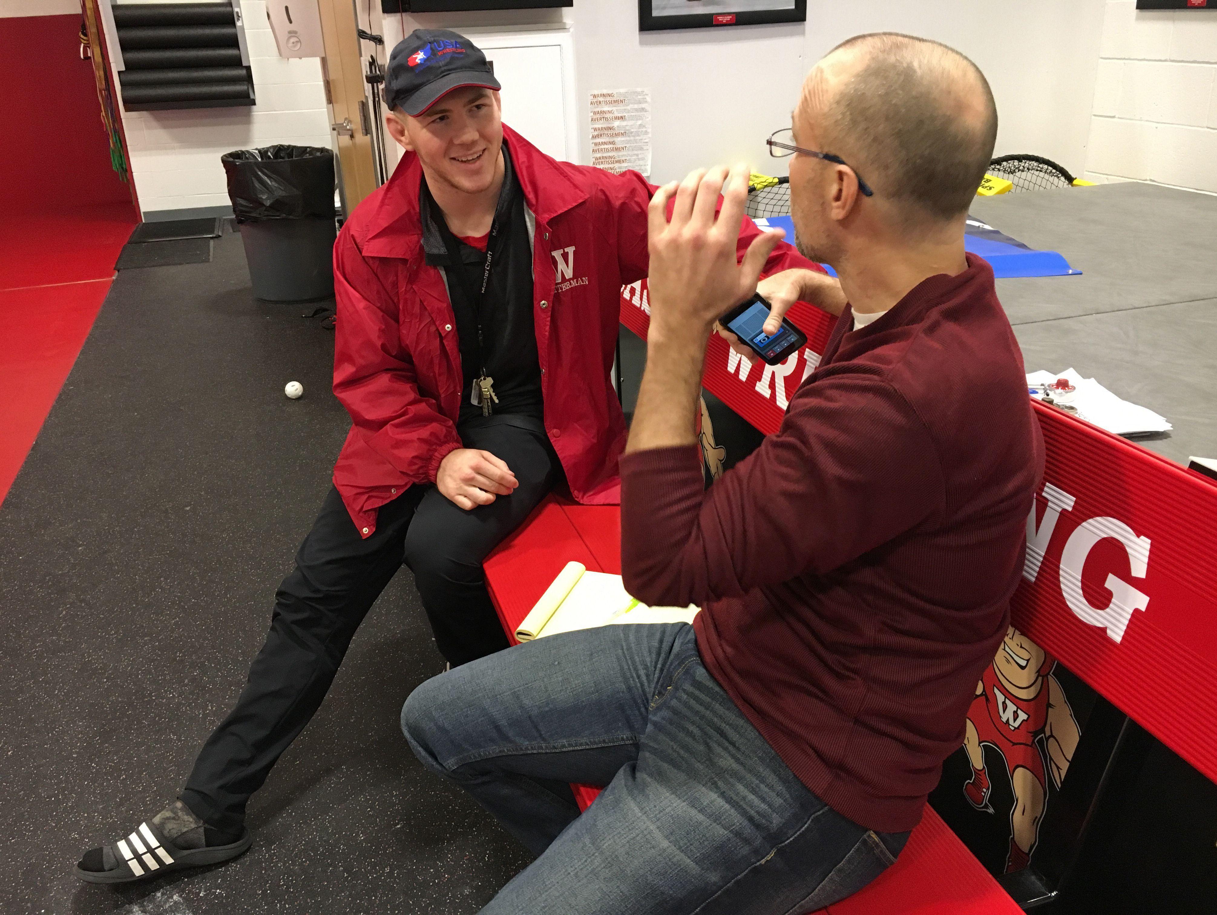 Gregg Doyel talks with Riley Lefever, a wrestler from Wabash College.
