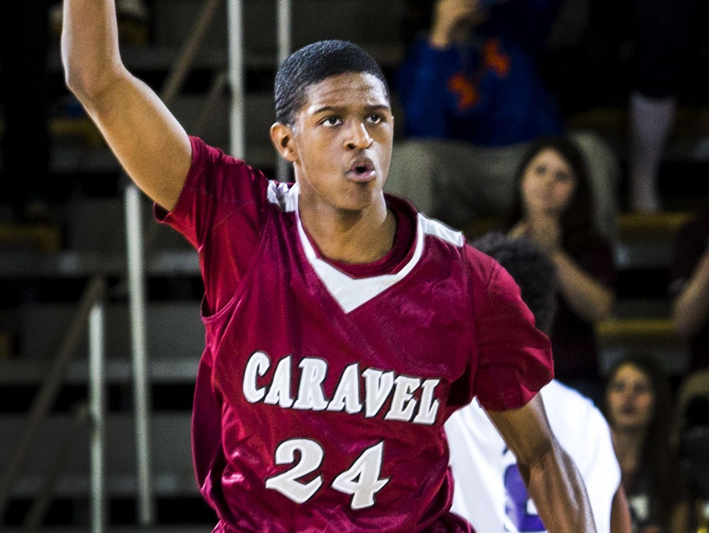 Caravel's O'Koye Parker celebrates after hitting a three in the second half of Caravel Academy's 48-47 win over St. Thomas More Academy in the DIAA Boy's State Basketball Tournament semi-finals at the Bob Carpenter Center in Newark on Thursday evening.
