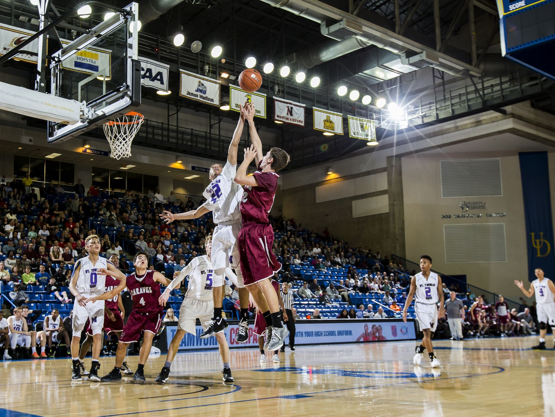 Caravel's Bradley Kaden puts up a shot over St. Thomas More's Alvin West in the first half of Caravel Academy's 48-47 win over St. Thomas More Academy in the DIAA Boy's State Basketball Tournament semi-finals at the Bob Carpenter Center in Newark on Thursday evening.